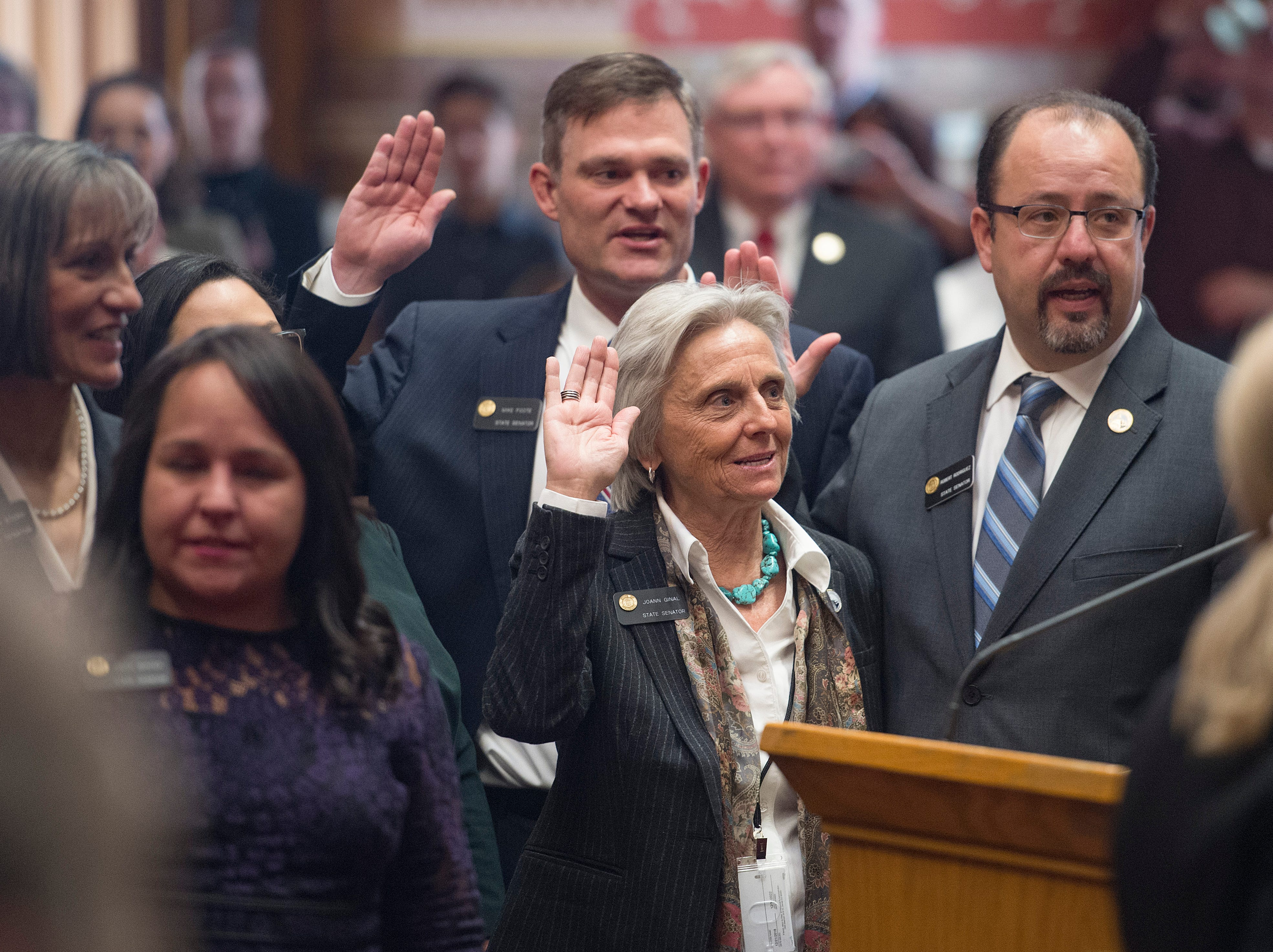 State Sen. Joann Ginal is sworn in with a group of new senators as the 72nd General Assembly convenes at the Colorado State Capitol on Friday, January 4, 2019.