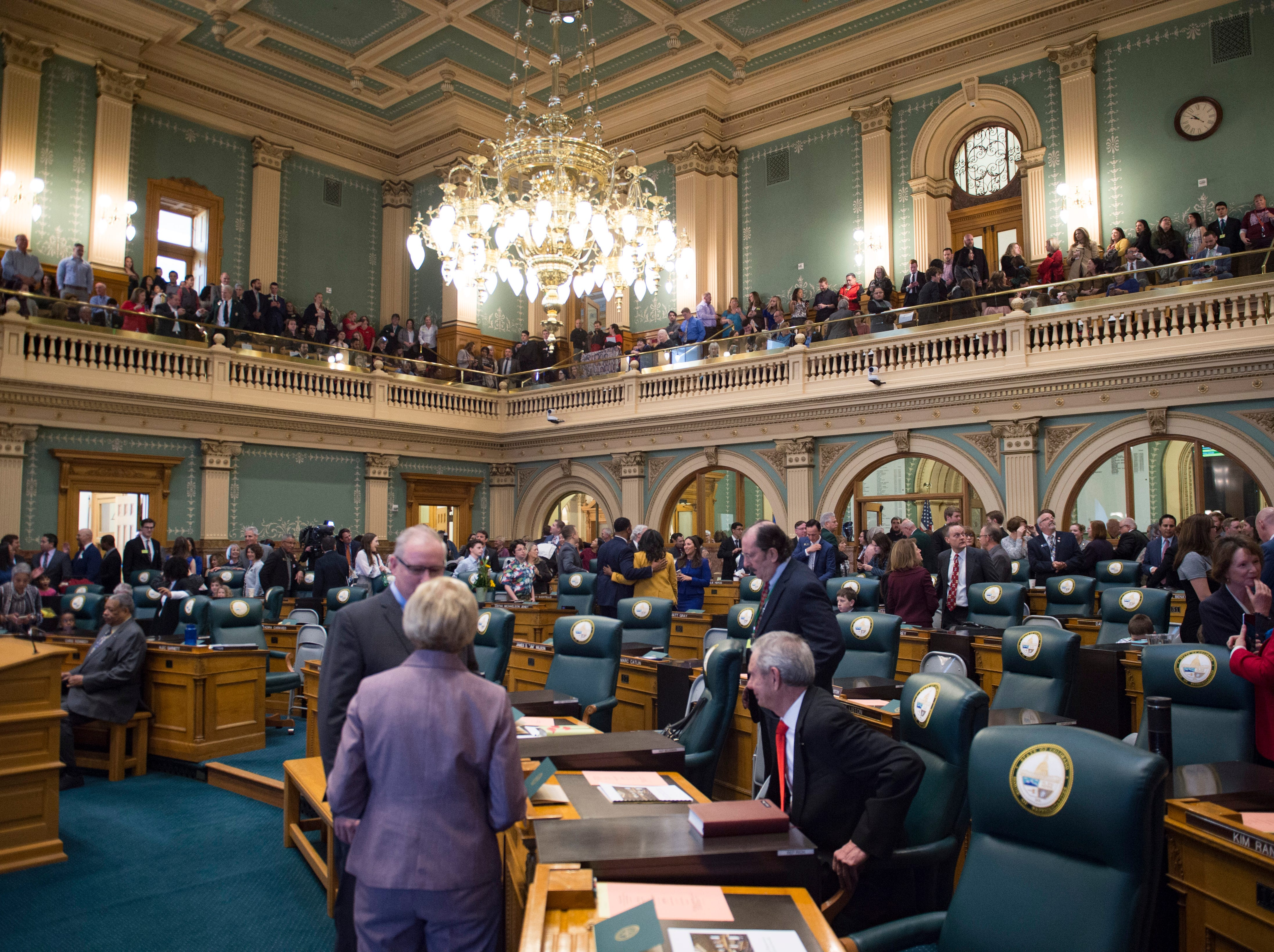 The Colorado House of Representatives take their seats as the 72nd General Assembly convenes at the Colorado State Capitol on Friday, January 4, 2019.