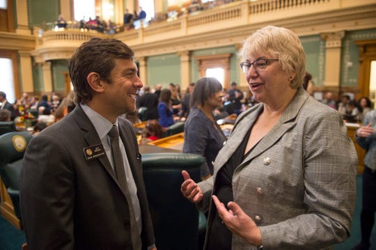 Representative Jeff Bridges talks with newly appointed Representative Cathy Kipp as the 72nd General Assembly convenes at the Colorado State Capitol on Friday, January 4, 2019. Kipp was appointed the night before to take over the vacant seat left by State Sen. Joann Ginal.