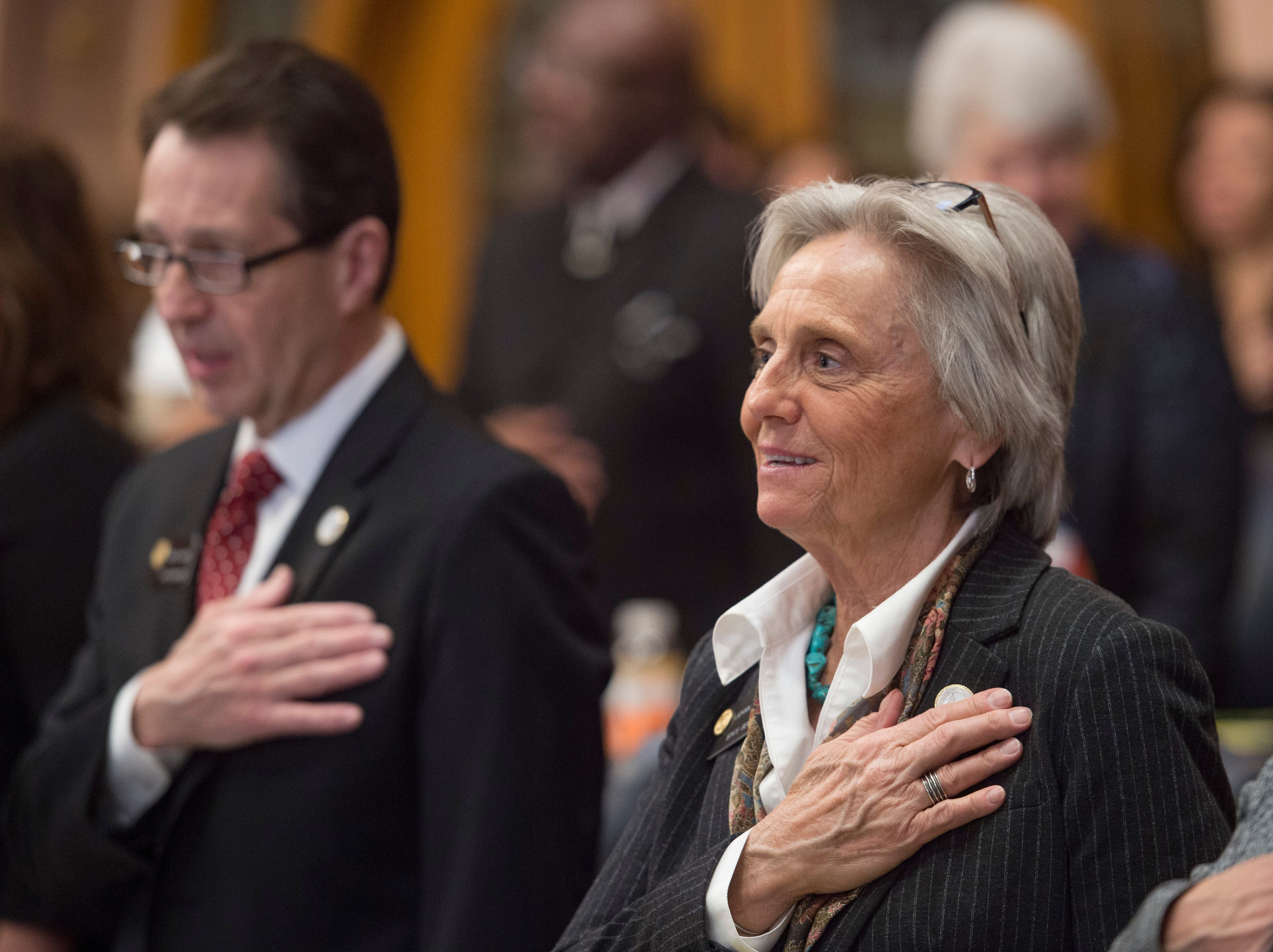 State Sen. Joann Ginal holds her hand over her heart during the National Anthem as the 72nd General Assembly convenes at the Colorado State Capitol on Friday, January 4, 2019.