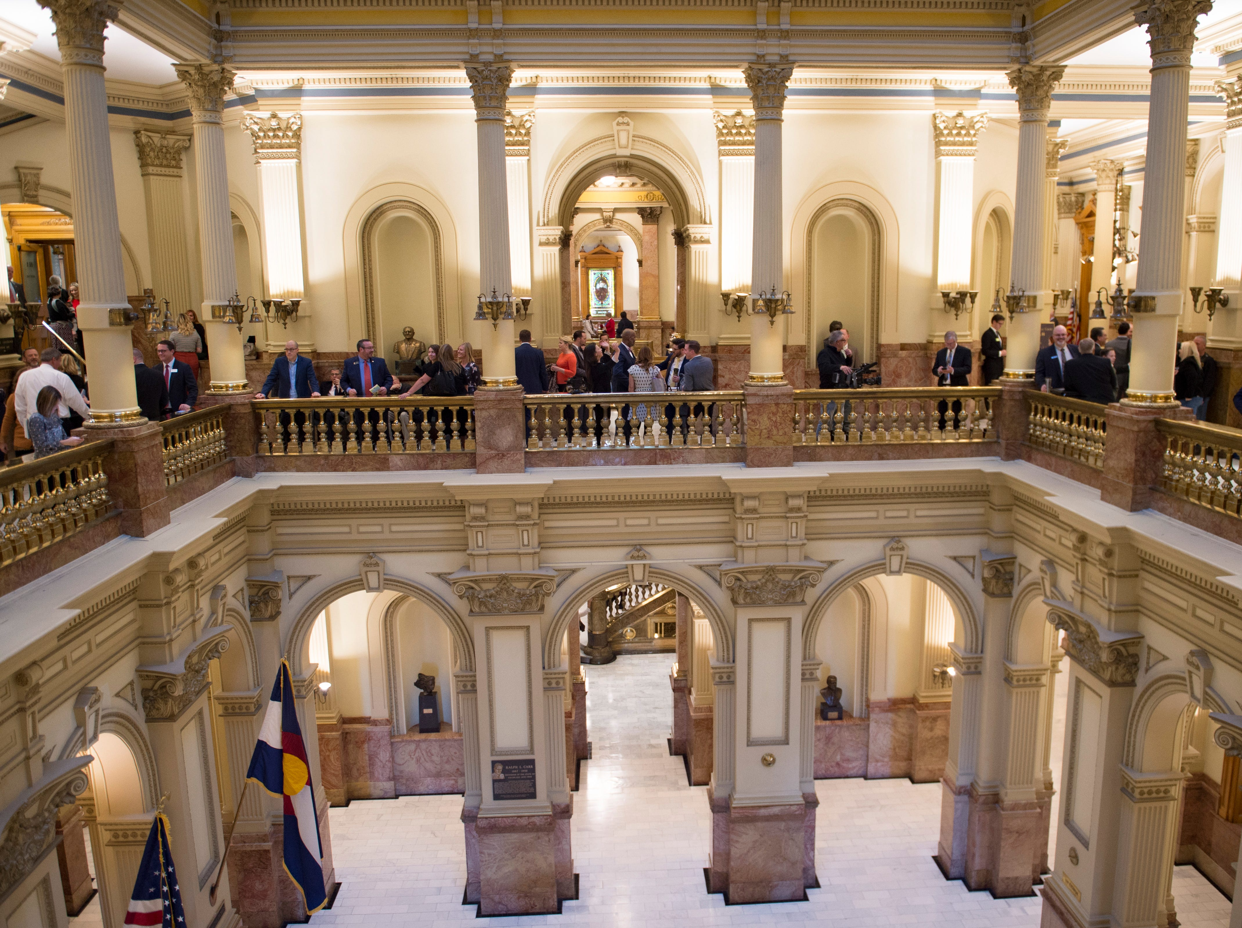 People gather on the second floor before the 72nd General Assembly convenes at the Colorado State Capitol on Friday, January 4, 2019.