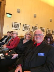Tom List and Laura Druse sit in overflow seating to watch the first State House of Representatives session of 2019.