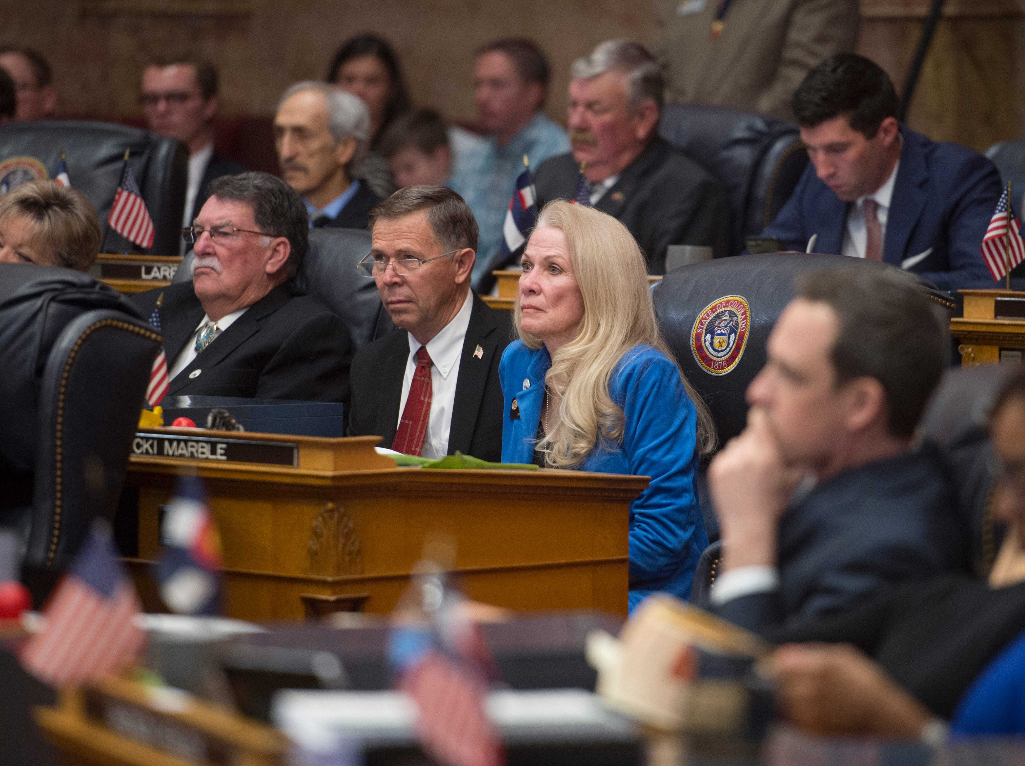 Representative Vicki Marble sits on the floor of the House as the 72nd General Assembly convenes at the Colorado State Capitol on Friday, January 4, 2019.