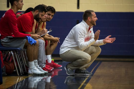 LaBelle High School varsity basketball Coach Zack Ward encourages his players during his team's game against Mariner High School Friday afternoon January 4, 2019, as part of the Lehigh New Year's Shootout held at Varsity Lakes Middle School in Lehigh Acres.