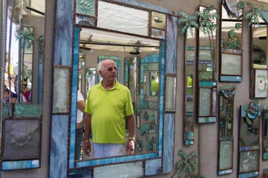 John Samz of Lehigh Acres looks at the art of Cindy Hirt in 2016.