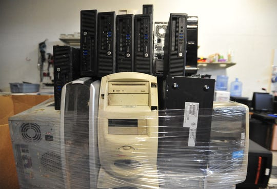 406 Recycling removes and destroys the hard drives from old computer towers and then bundles the towers for shipment to another facility where they are recycled.