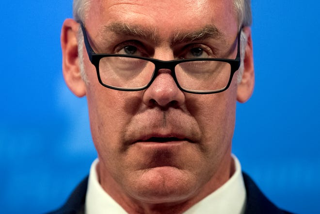 FILE - In this Sept. 29, 2017 file photo, then Interior Secretary Ryan Zinke speaks on the Trump Administration's energy policy at the Heritage Foundation in Washington. As former U.S. Interior Secretary Zinke departs Trump's Cabinet amid a cloud of investigations, he says he's lived up to the conservation ideals of Teddy Roosevelt and insists the myriad allegations against him are unfounded. Zinke told The Associated Press that he quit President Donald Trump's Cabinet on his own terms, despite indications he was pressured by the White House to resign effective Wednesday, Jan. 2, 2019. (AP Photo/Andrew Harnik, File)