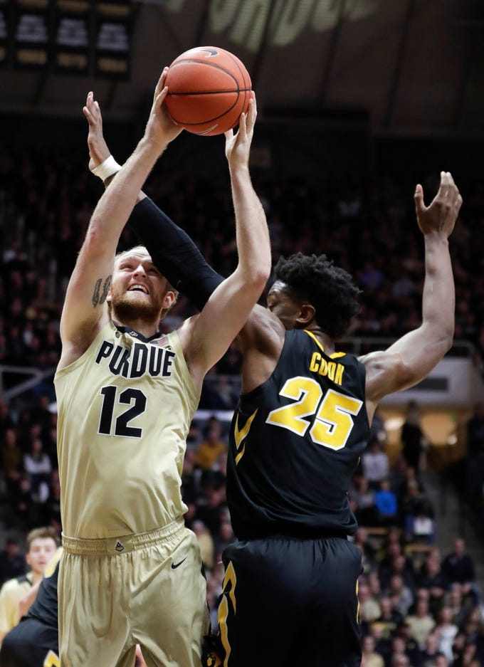 Purdue forward Evan Boudreaux (12) shoots over Iowa forward Tyler Cook (25) during the second half of an NCAA college basketball game in West Lafayette, Ind., Thursday, Jan. 3, 2019. Purdue defeated Iowa 86-70.