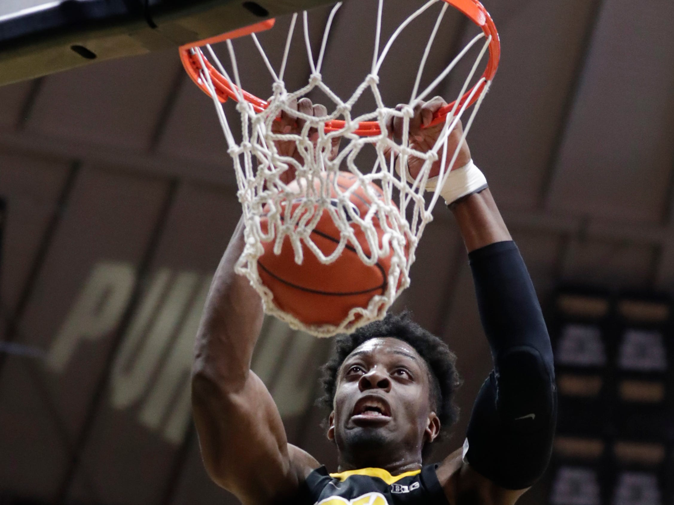 Iowa forward Tyler Cook (25) dunks against Purdue during the first half of an NCAA college basketball game in West Lafayette, Ind., Thursday, Jan. 3, 2019.