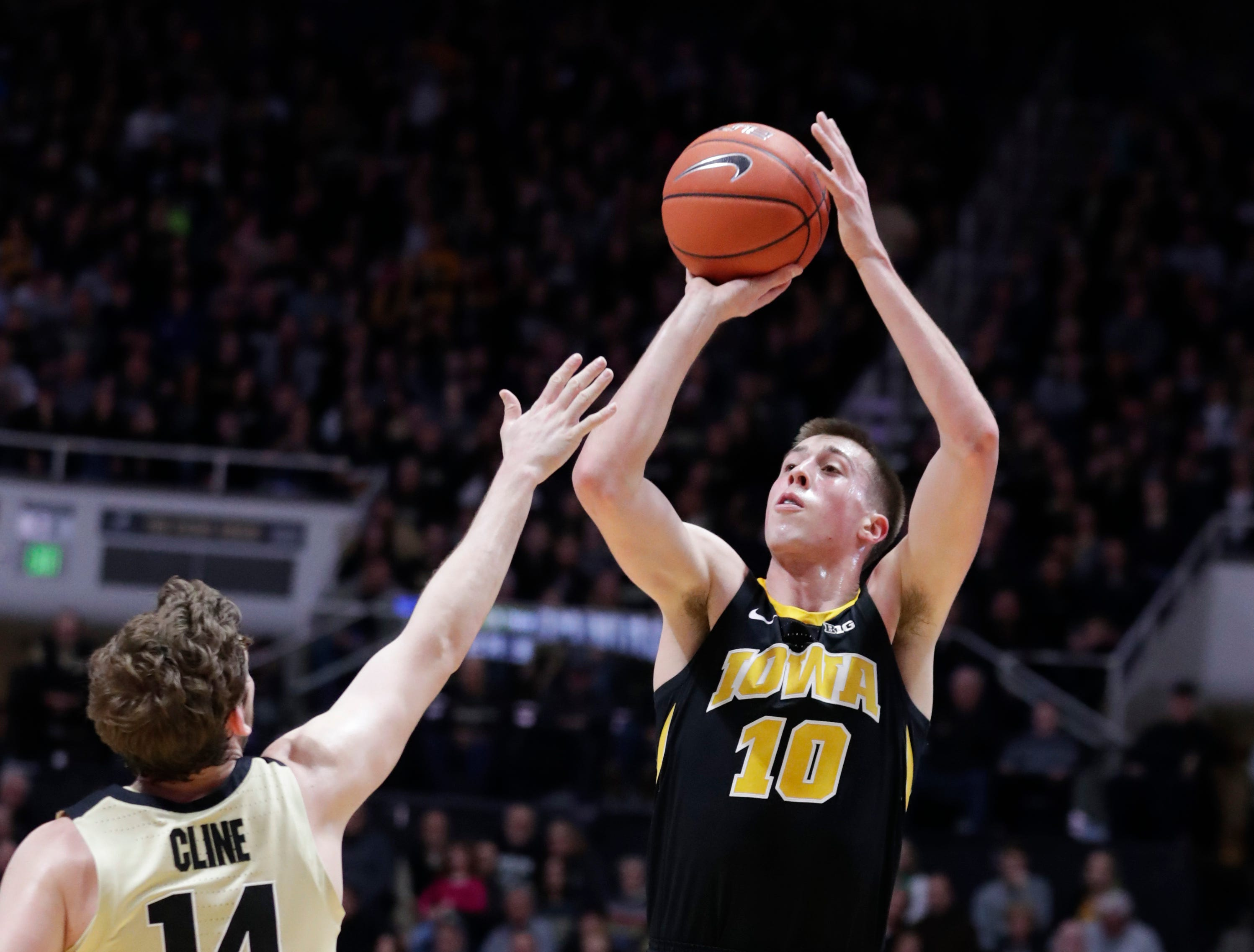 Iowa guard Joe Wieskamp (10) shoots over Purdue guard Ryan Cline (14) during the first half of an NCAA college basketball game in West Lafayette, Ind., Thursday, Jan. 3, 2019.