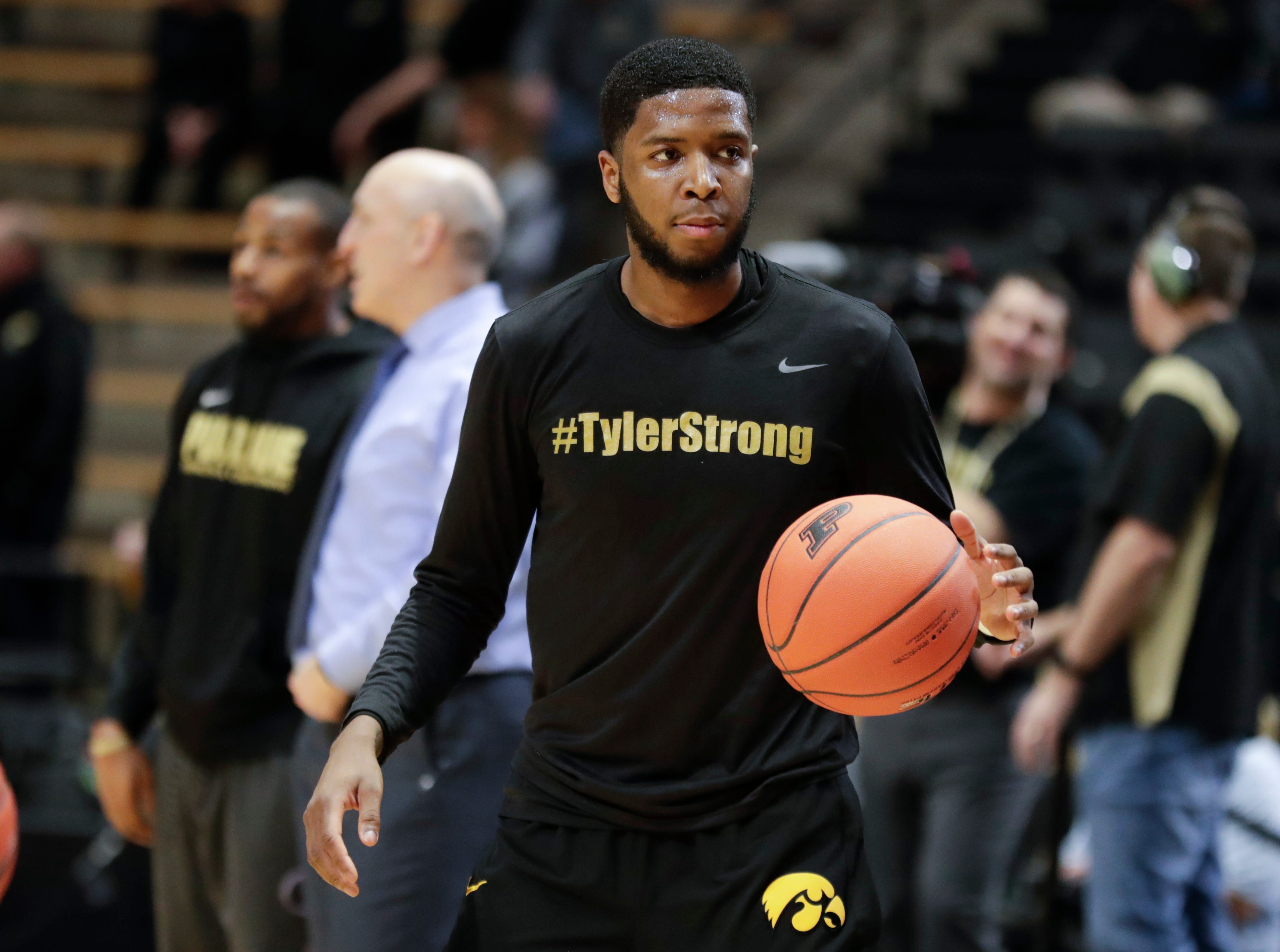 Iowa guard Isaiah Moss (4) wears a shirt honoring Tyler Trent before an NCAA college basketball game against Iowa in West Lafayette, Ind., Thursday, Jan. 3, 2019. Both Purdue and Iowa will pay their respects to late Boilermakers fan Tyler Trent on by wearing #TylerStrong T-shirts in his honor. Trent, a superfan who inspired people across the globe during his hard-fought battle with cancer, died this week. He was 20.