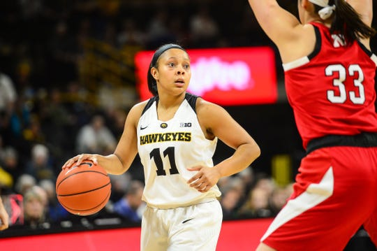 Iowa Hawkeyes guard Tania Davis (11) controls the ball as Nebraska Cornhuskers guard/forward Taylor Kissinger (33) defends during the first quarter at Carver-Hawkeye Arena.
