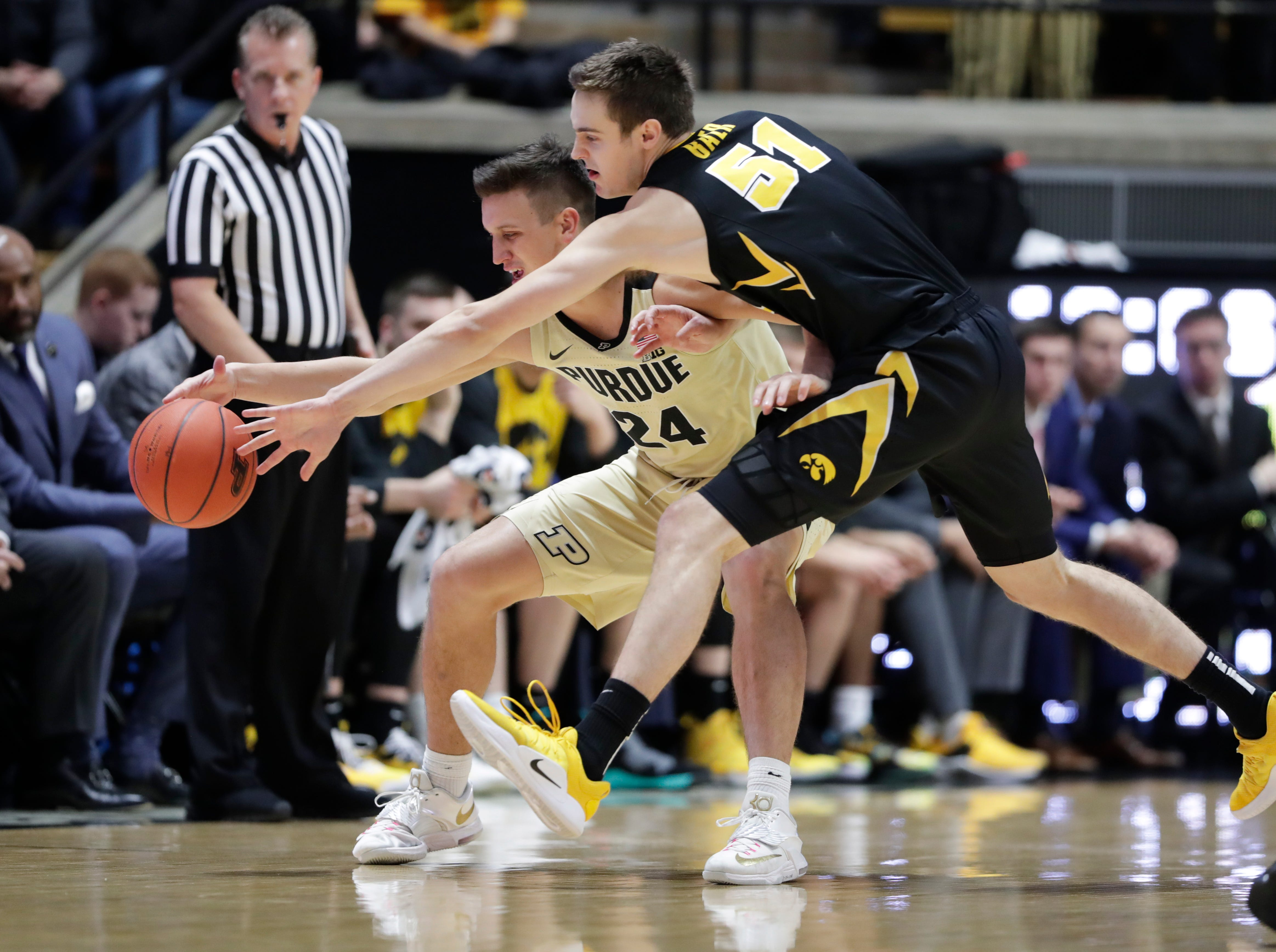 Iowa forward Nicholas Baer (51) attempts to knock the ball away from Purdue forward Grady Eifert (24) during the first half of an NCAA college basketball game in West Lafayette, Ind., Thursday, Jan. 3, 2019.