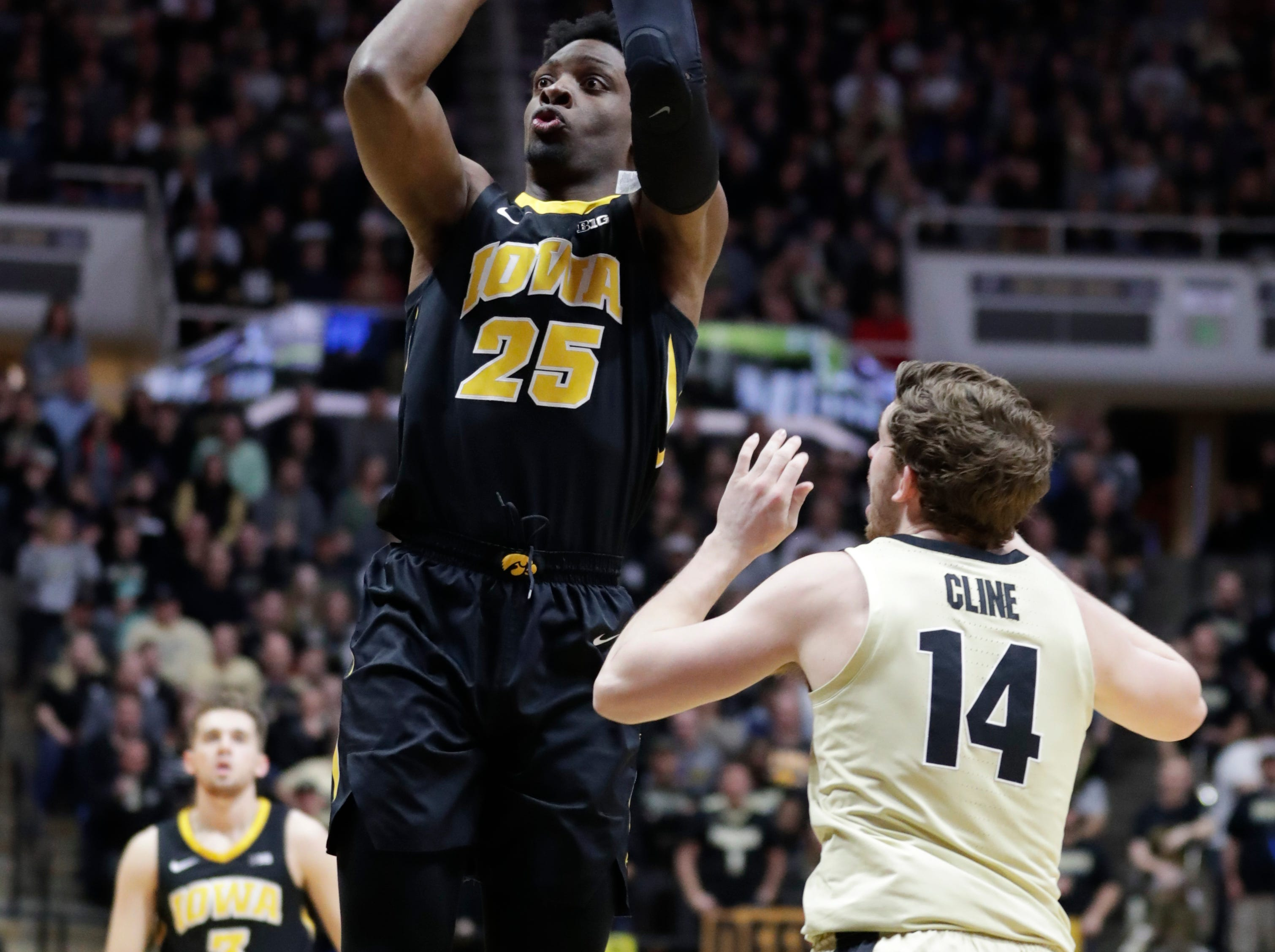 Iowa forward Tyler Cook (25) shoots over Purdue guard Ryan Cline (14) during the first half of an NCAA college basketball game in West Lafayette, Ind., Thursday, Jan. 3, 2019.