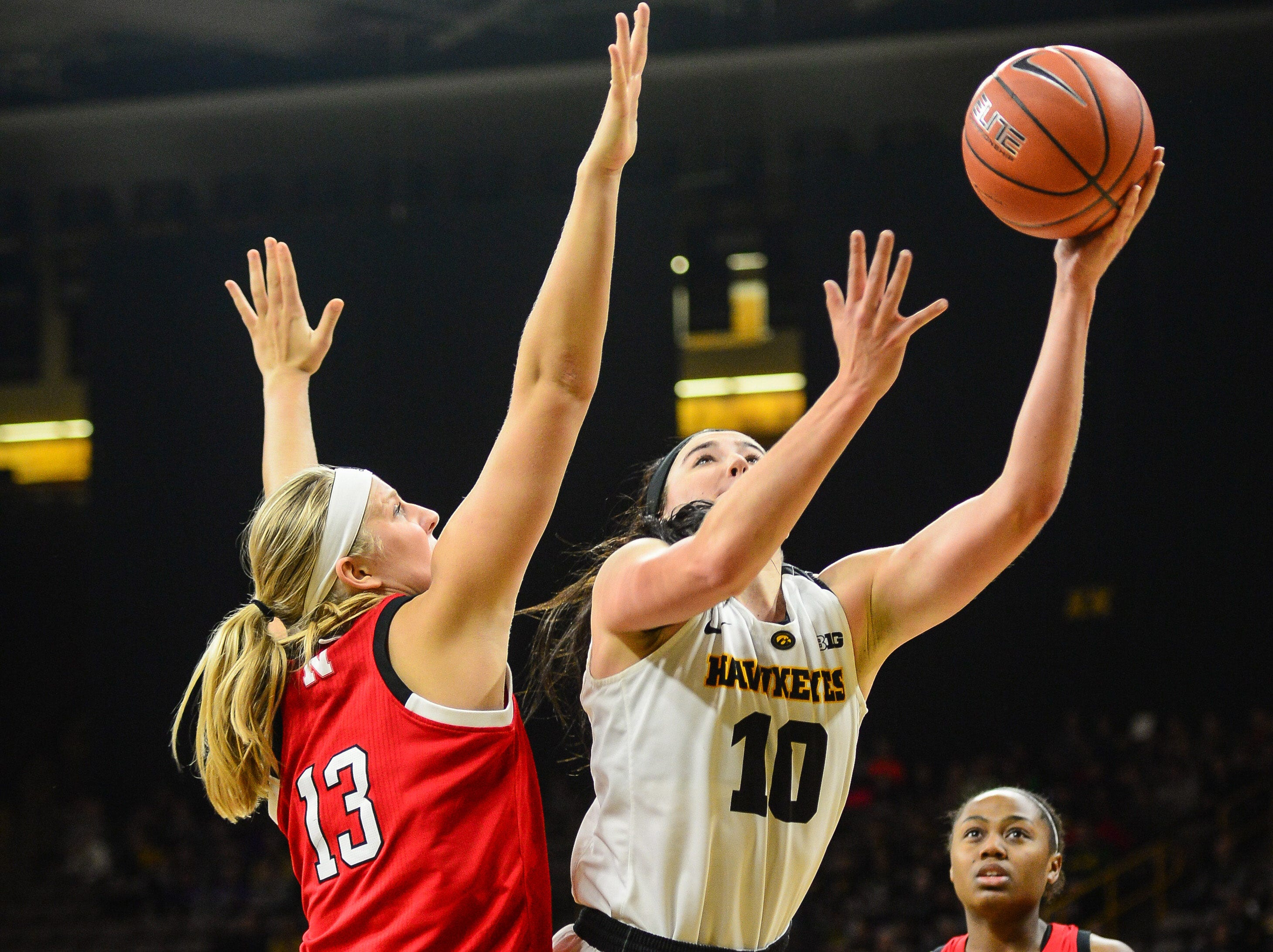 Iowa Hawkeyes forward Megan Gustafson (10) shoots the ball as Nebraska Cornhuskers forward Ashtyn Veerbeek (13) defends during the first quarter at Carver-Hawkeye Arena.