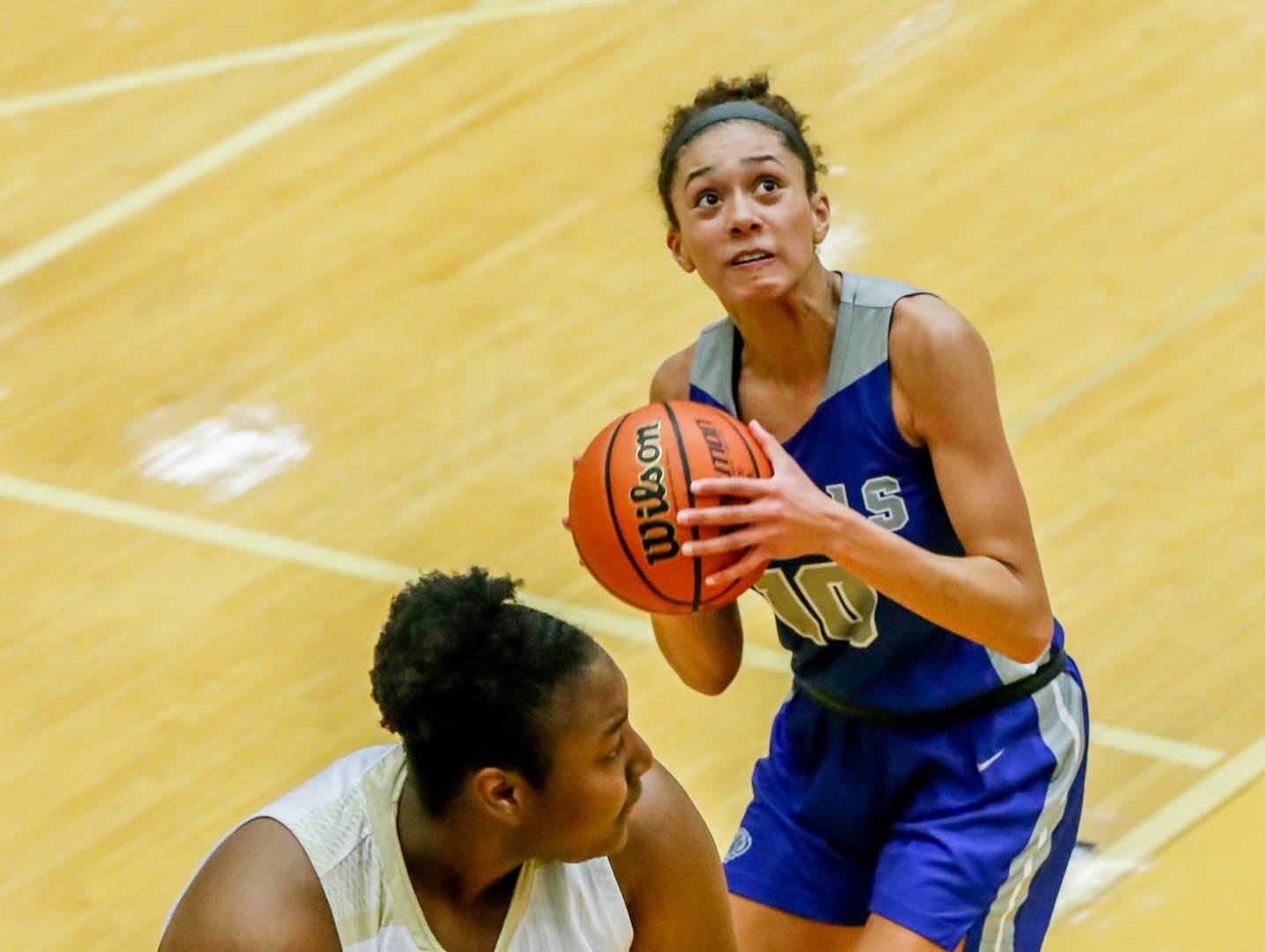 Hamilton South Eastern's Amaya Hamilton (10), shoots a basket over Warren Central High School's Cydni Dodd (50), during a game between Hamilton Southeastern High School and Warren Central High School, held at Warren on Thursday, Jan. 3, 2019.