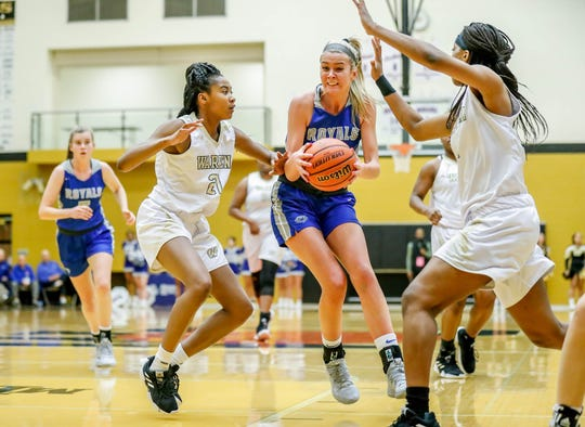 Warren Central's K'ja Talley (21), and Alaysia Davis (4), guard Hamilton Southeastern's Sydney Parrish (33), during a game between Hamilton Southeastern High School and Warren Central High School, held at Warren on Thursday, Jan. 3, 2019.