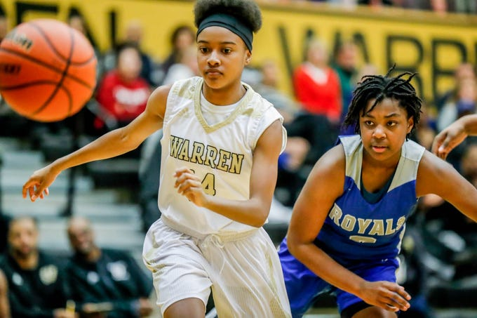 Warren Central High School's Le'aije Ellington (14), and Hamilton South Eastern's Malea Jackson (3), chase a loose ball during a game between Hamilton Southeastern High School and Warren Central High School, held at Warren on Thursday, Jan. 3, 2019.