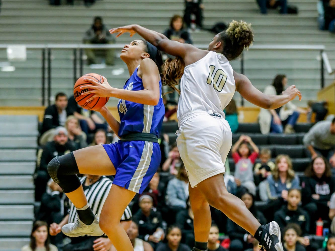 Warren Central High School's Shaila Beeler (10), tries to block a shot by Hamilton South Eastern's Tayah Irvin (21), during a game between Hamilton Southeastern High School and Warren Central High School, held at Warren on Thursday, Jan. 3, 2019.