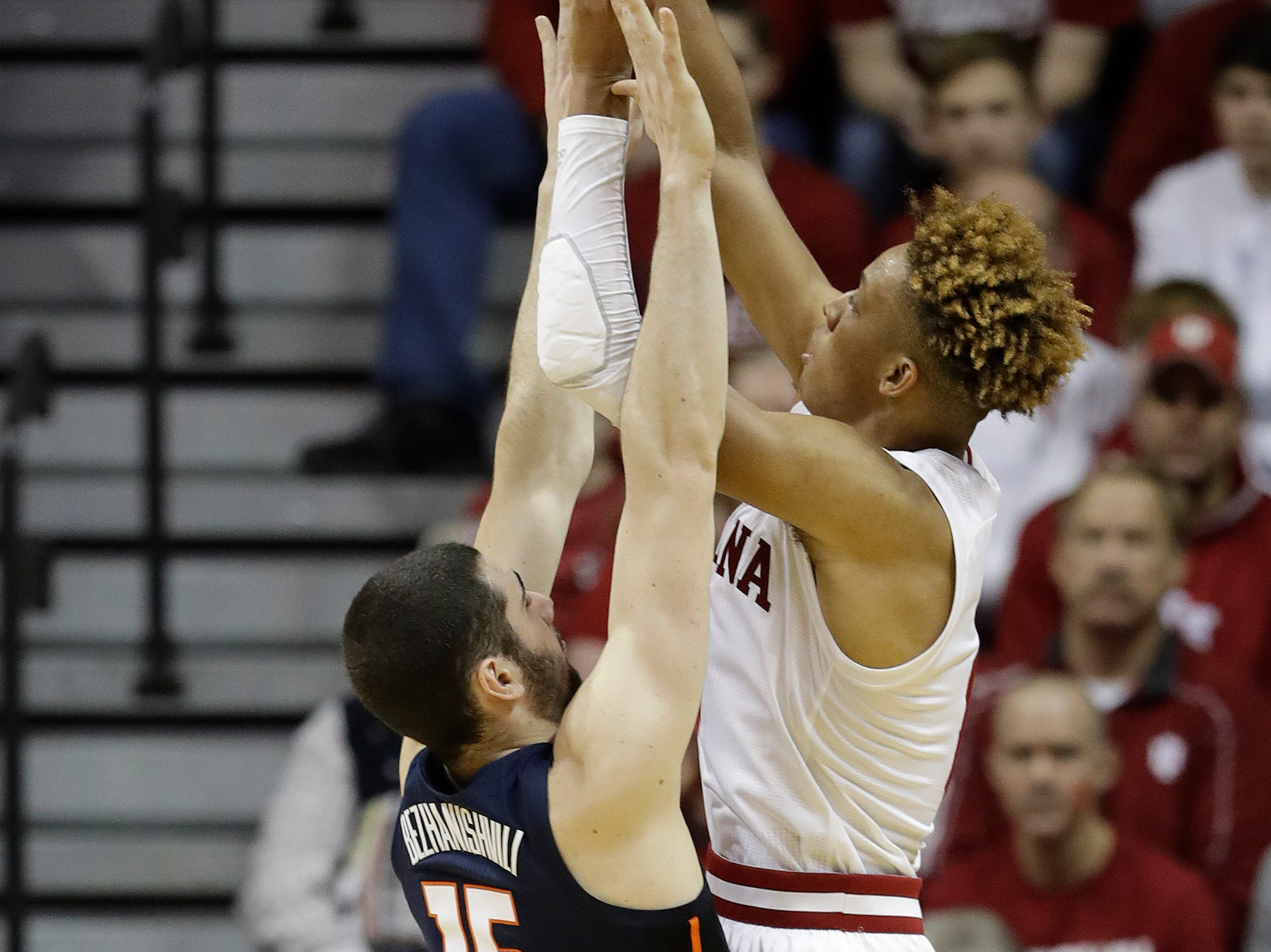 Indiana's Romeo Langford (0) shoots over Illinois' Giorgi Bezhanishvili (15).