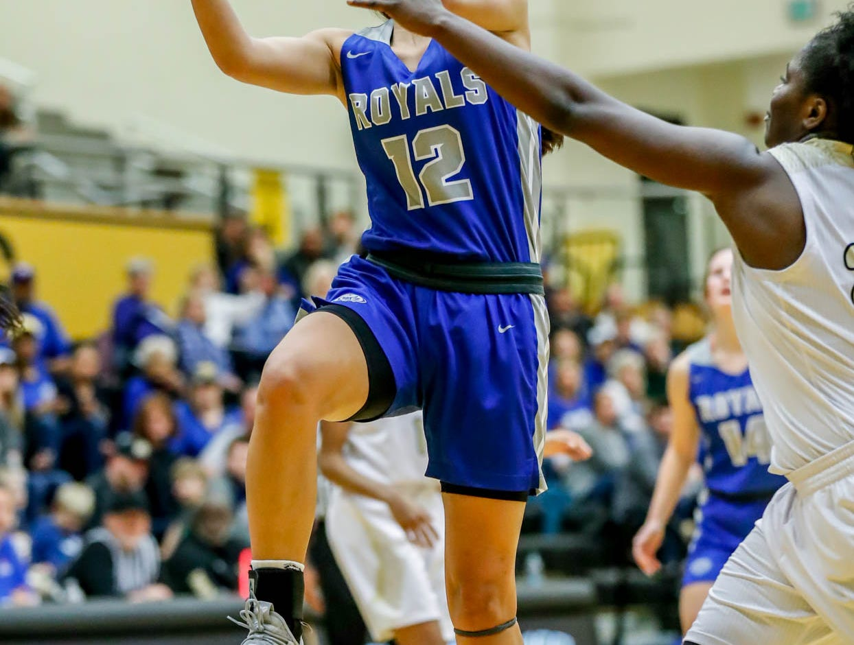 Hamilton South Eastern's Jackie Maulucci (12), shoots a layup during a game between Hamilton Southeastern High School and Warren Central High School, held at Warren on Thursday, Jan. 3, 2019.