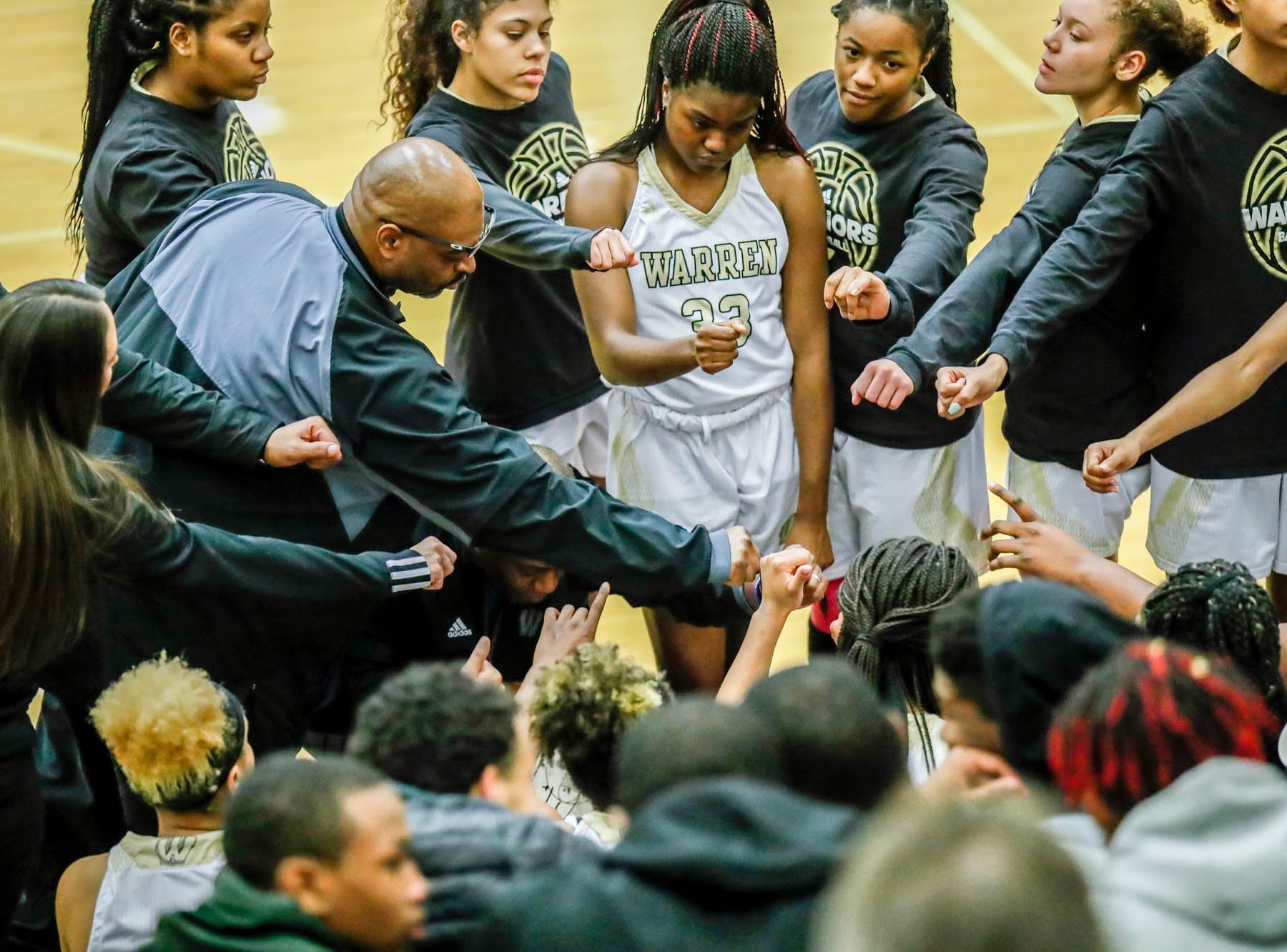 Warren Central High School's coaches and players put their fists in for team spirit during a game between Hamilton Southeastern High School and Warren Central High School, held at Warren on Thursday, Jan. 3, 2019.