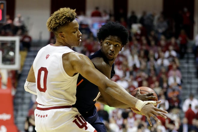 Illinois' Andres Feliz (10) is defended by Indiana's Romeo Langford (0) during the first half of an NCAA college basketball game Thursday, Jan. 3, 2019, in Bloomington, Ind.