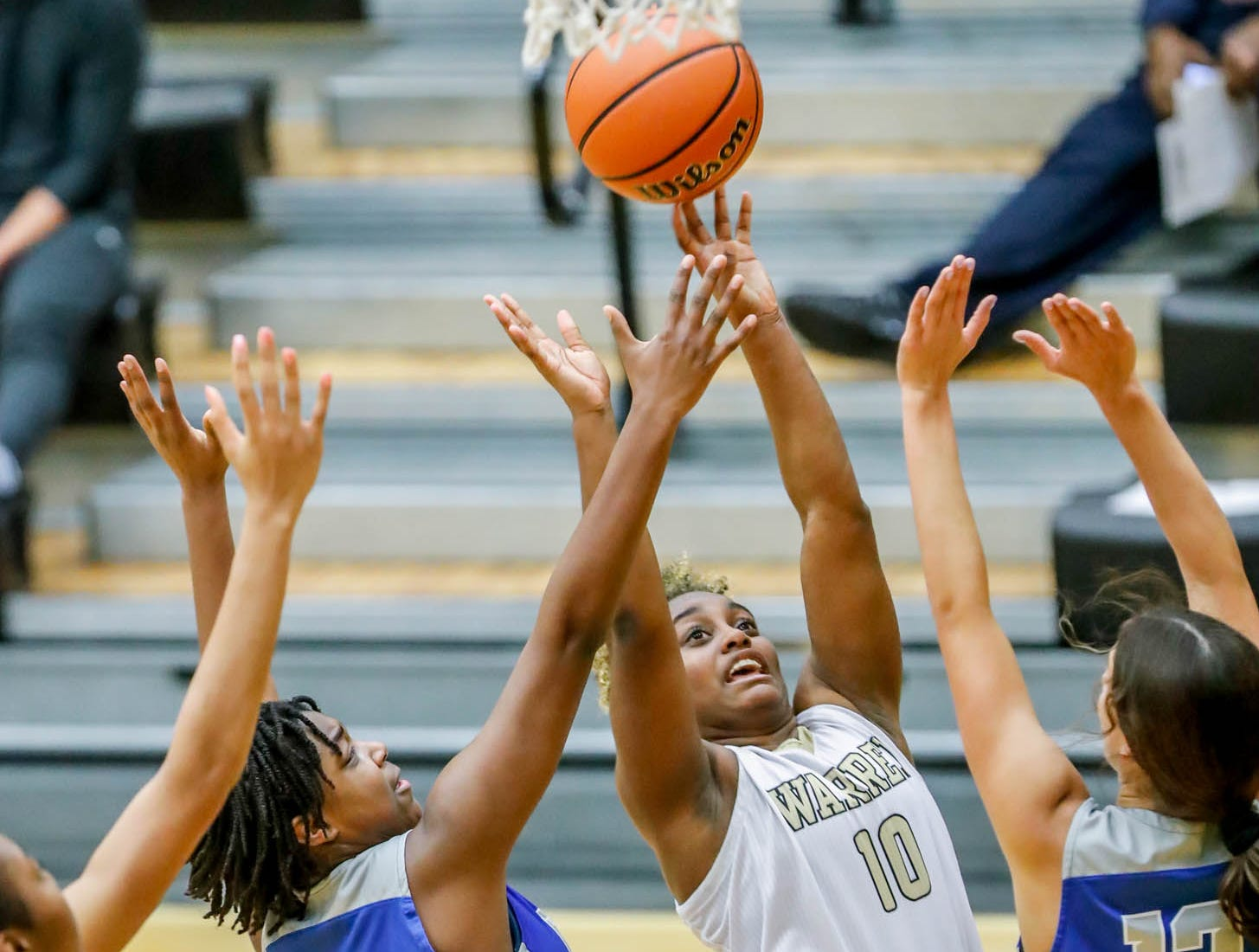 Players Hamilton South Eastern's Malea Jackson (3), Warren Central High School's Shaila Beeler (10), and Hamilton South Eastern's Jackie Maulucci (12), jump for a rebound during a game between Hamilton Southeastern High School and Warren Central High School, held at Warren on Thursday, Jan. 3, 2019.