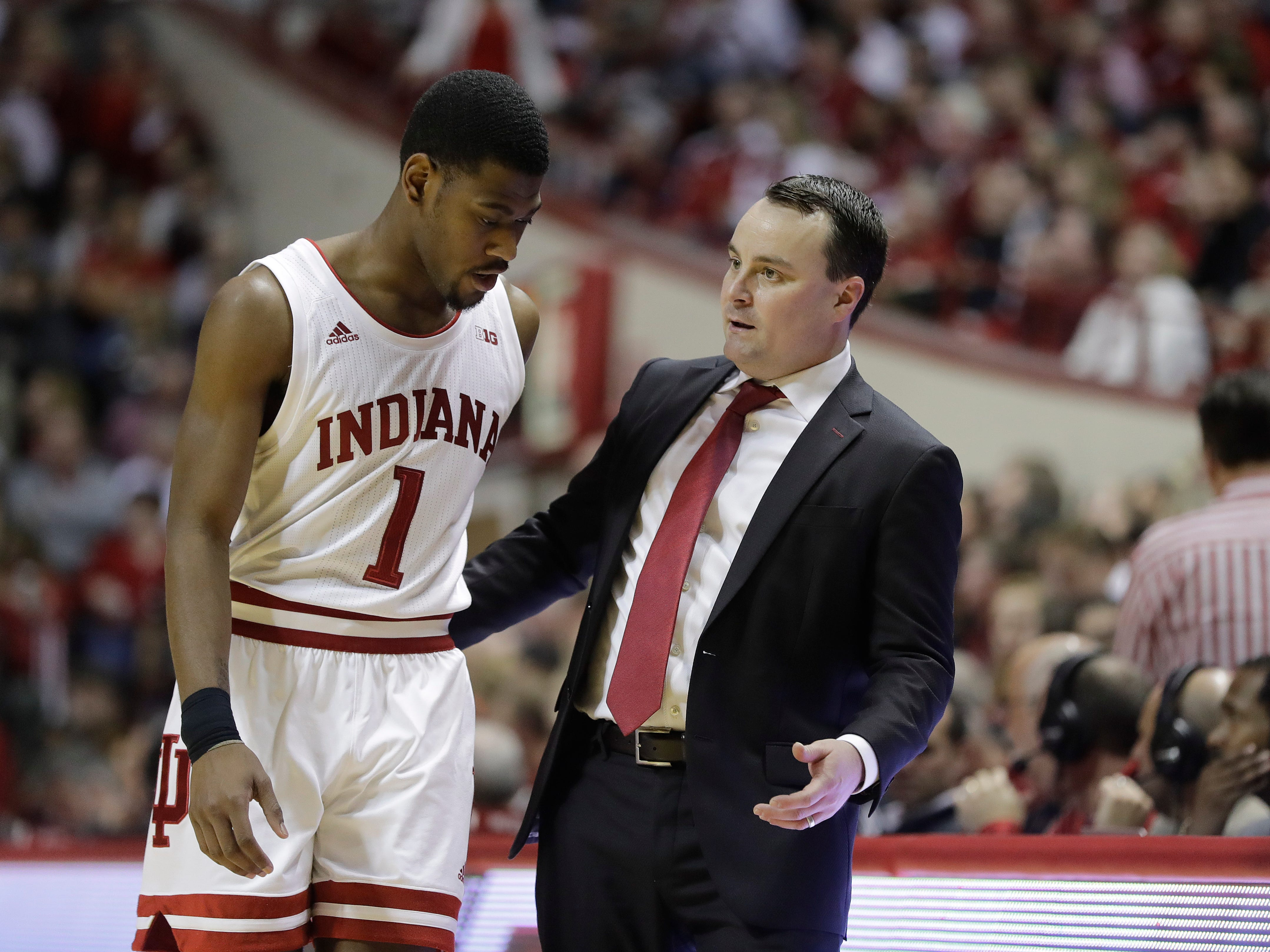 Indiana coach Archie Miller talks with Aljami Durham during the second half of the team's NCAA college basketball game against Illinois, Thursday, Jan. 3, 2019, in Bloomington, Ind. Indiana won 73-65.