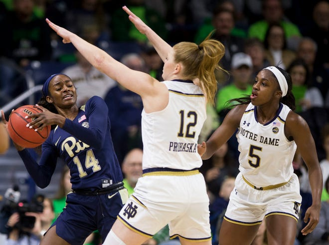 Pittsburgh's Kauai Bradley (14) gets pressure from Notre Dame's Abby Prohaska (12) and Jackie Young (5) during the first half of an NCAA college basketball game Thursday, Jan. 3, 2019, in South Bend, Ind.