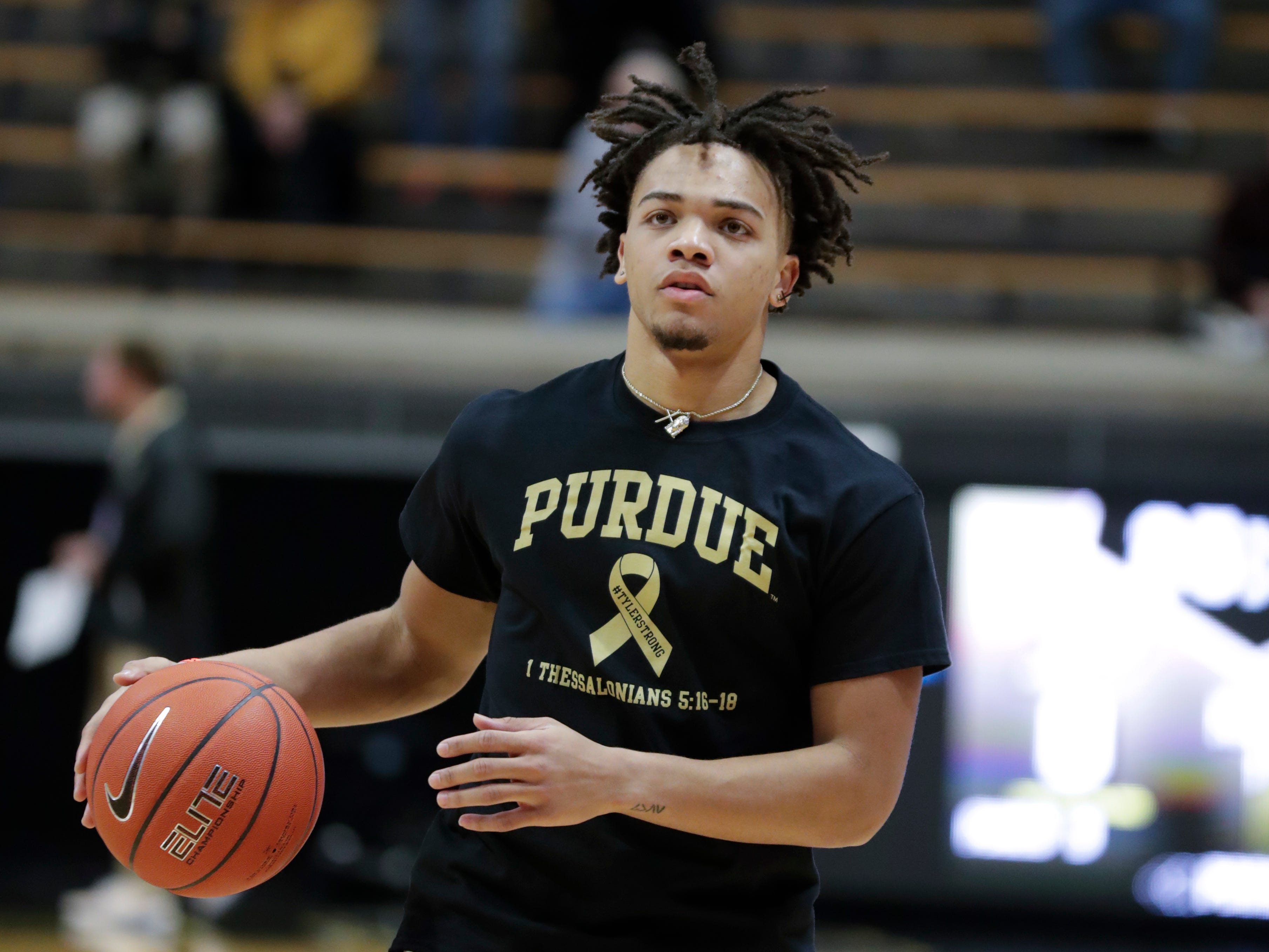 Purdue guard Carsen Edwards (3) wears a shirt honoring Tyler Trent before an NCAA college basketball game against Iowa in West Lafayette, Ind., Thursday, Jan. 3, 2019. Both Purdue and Iowa will pay their respects to late Boilermakers fan Tyler Trent on by wearing #TylerStrong T-shirts in his honor. Trent, a superfan who inspired people across the globe during his hard-fought battle with cancer, died this week. He was 20.