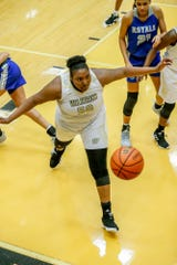 Warren Central High School's Cydni Dodd (50), backs off a ball heading out of bounds during a game between Hamilton Southeastern High School and Warren Central High School, held at Warren on Thursday, Jan. 3, 2019.