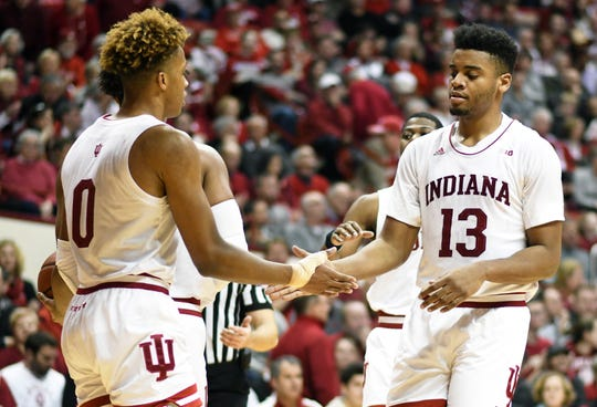 Indiana Hoosiers guard Romeo Langford (0) and Indiana Hoosiers forward Juwan Morgan (13) high five during the game against Illinois at Simon Skjodt Assembly Hall in Bloomington, Ind., on Thursday, Jan. 3, 2019.