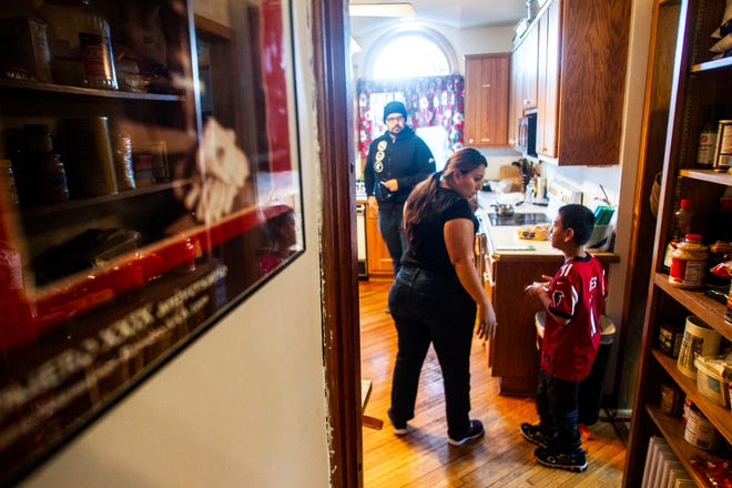 Honduran asylum seeker Heybi Jakelin Torres-Toro talks with her son, Josue Isaac Lopez-Torres, 10, on Friday, Jan. 4, 2019, at the Catholic Worker House in Iowa City. Torres-Toro was getting ready to drive to Cedar Rapids to meet with ICE agents for the first time.