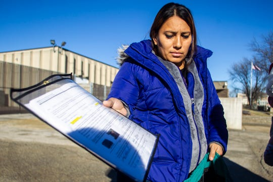 Heybi Jakelin Torres-Toro holds a document after her meeting with ICE on Friday, Jan. 4, 2019, at a Homeland Security Investigations office in Cedar Rapids.