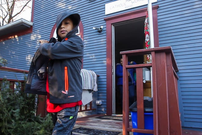 Honduran asylum seeker Heybi Jakelin Torres-Toro and her son Josue Isaac Lopez-Torres, 10, walk out to a car on their way to a meeting with ICE on Friday, Jan. 4, 2019, at the Catholic Worker House in Iowa City.