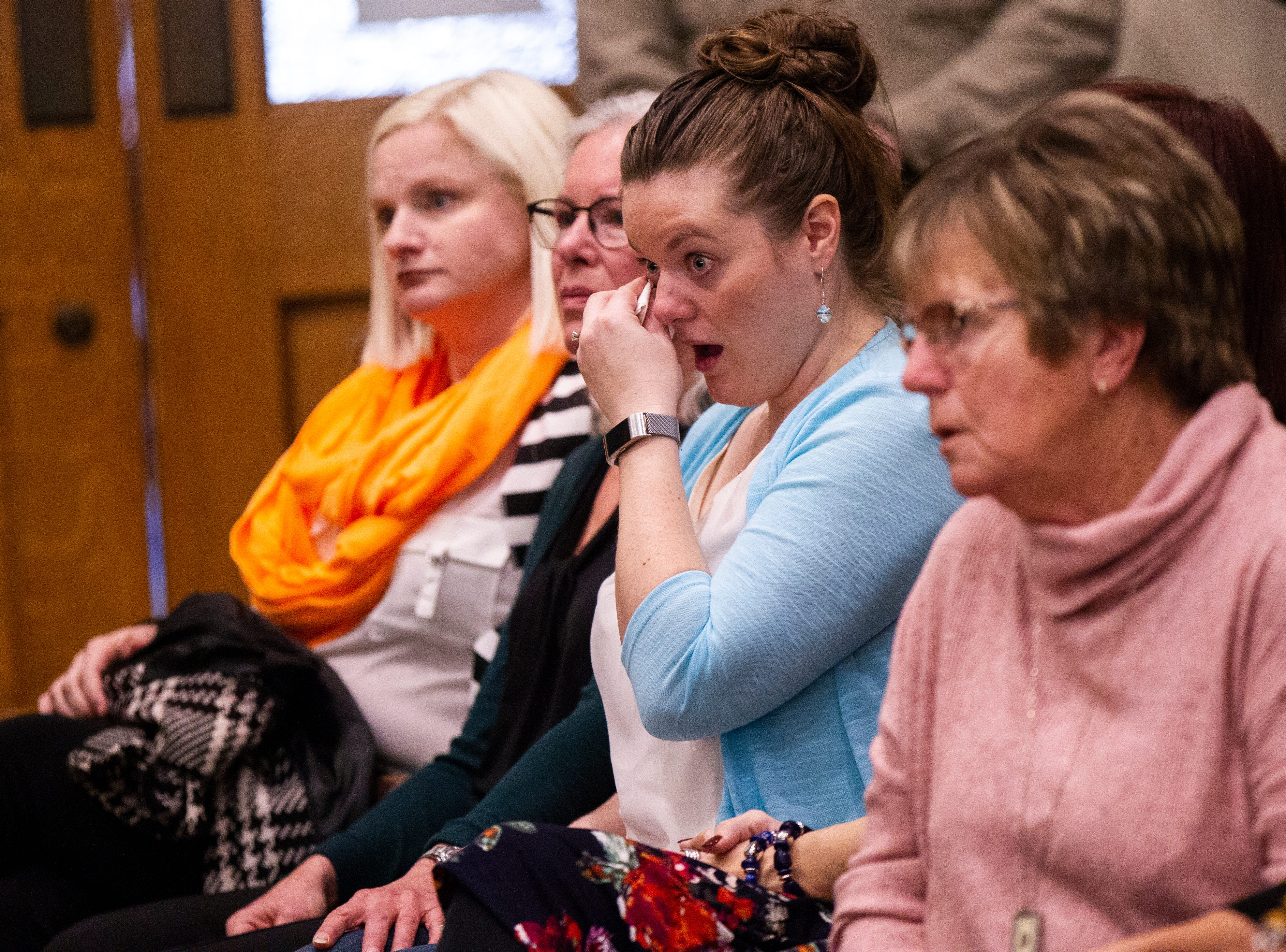 Harmony Hauser, Johnathan Wieseler's fiancé, wipes a tear while sitting with family members of victims during a sentencing hearing for Curtis Cortez Jones on Friday, Jan. 4, 2019, at the Johnson County Courthouse, in Iowa City, Iowa.