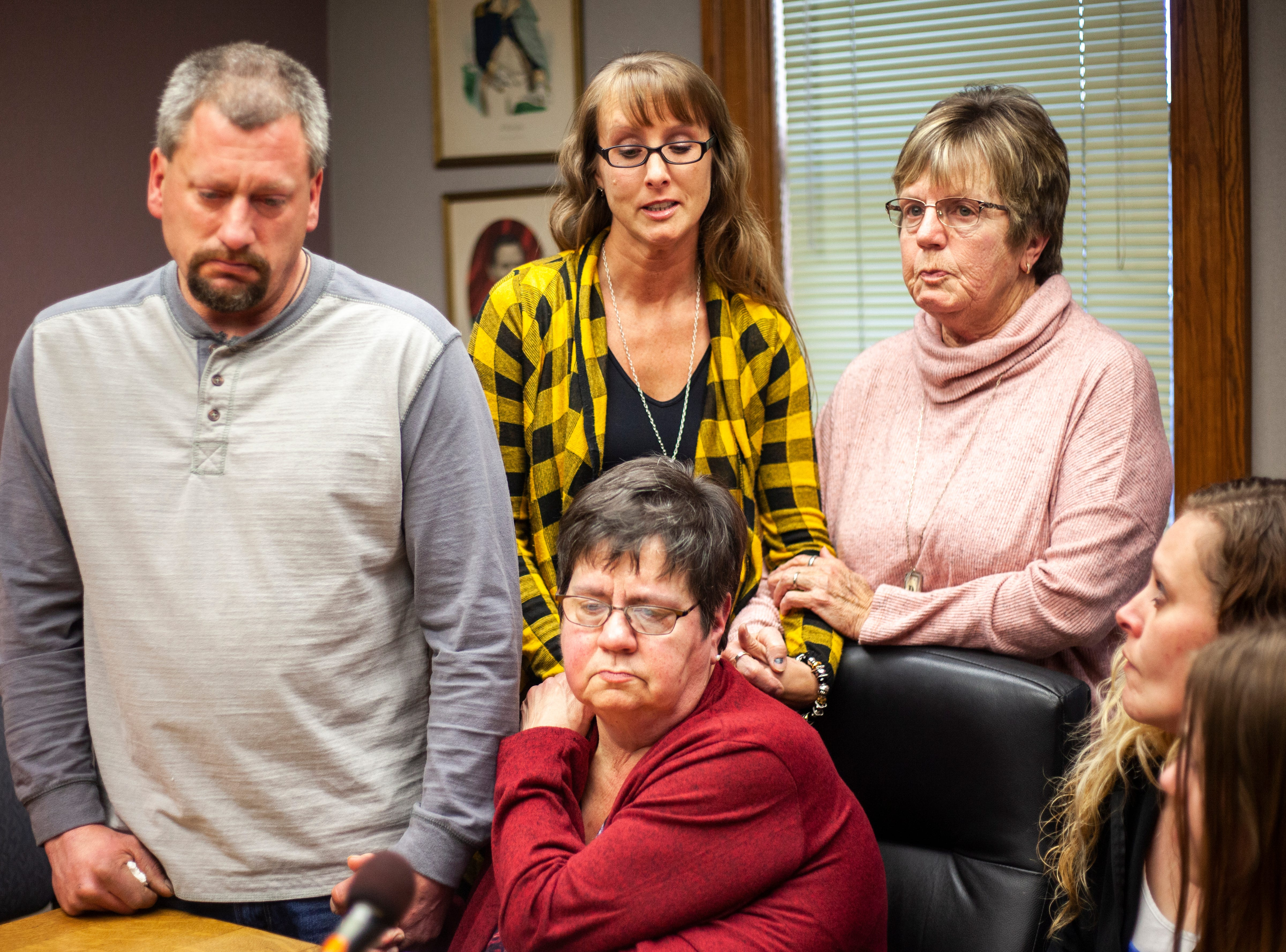 Lucy Miller (yellow) is comforted by family members including Ricky Lillie's mother, Peggy Armstrong (red) while giving a statement after a sentencing hearing for Curtis Cortez Jones on Friday, Jan. 4, 2019, at the Johnson County Courthouse, in Iowa City, Iowa.