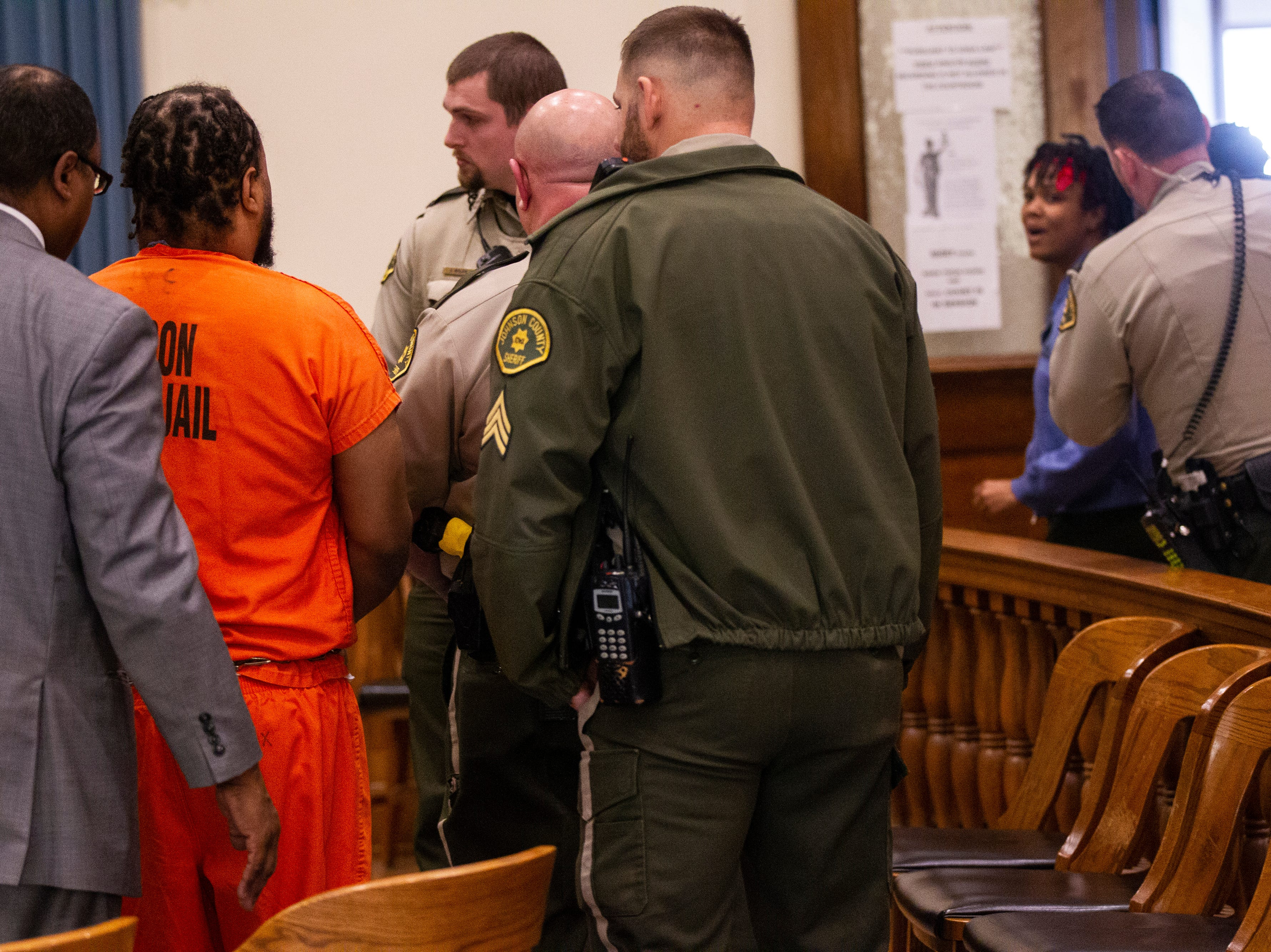 Curtis Cortez Jones walks out of the courtroom after reading a statement claiming his innocence as a family member is ushered away by a sheriff deputy during a sentencing hearing for the murder of Ricky Ray Lillie on Friday, Jan. 4, 2019, at the Johnson County Courthouse.