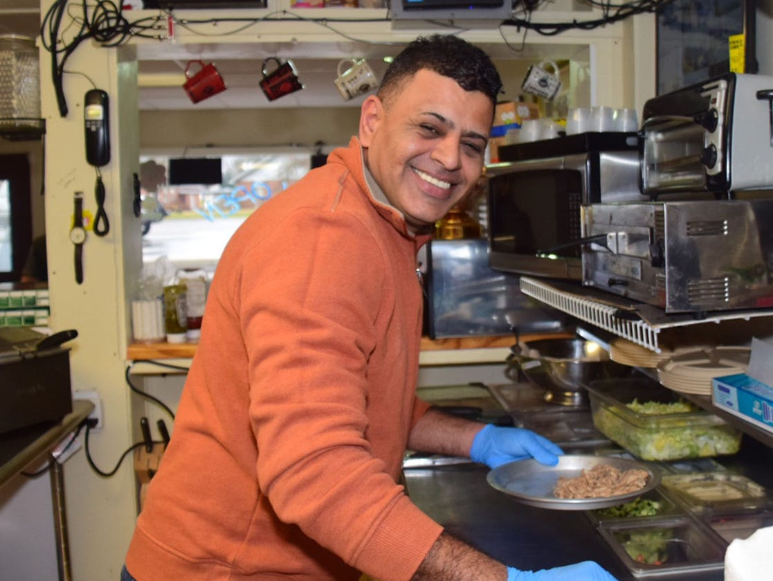 Majid Mahdi flashes his thousand watt smile in the kitchen of Kib Kab Deli Wednesday, Dec. 2.