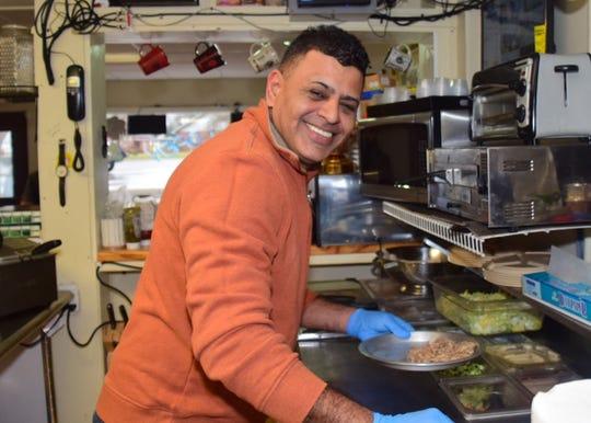 Majid Mahdi in the kitchen of Kib Kab Deli on Wednesday, Jan. 2.