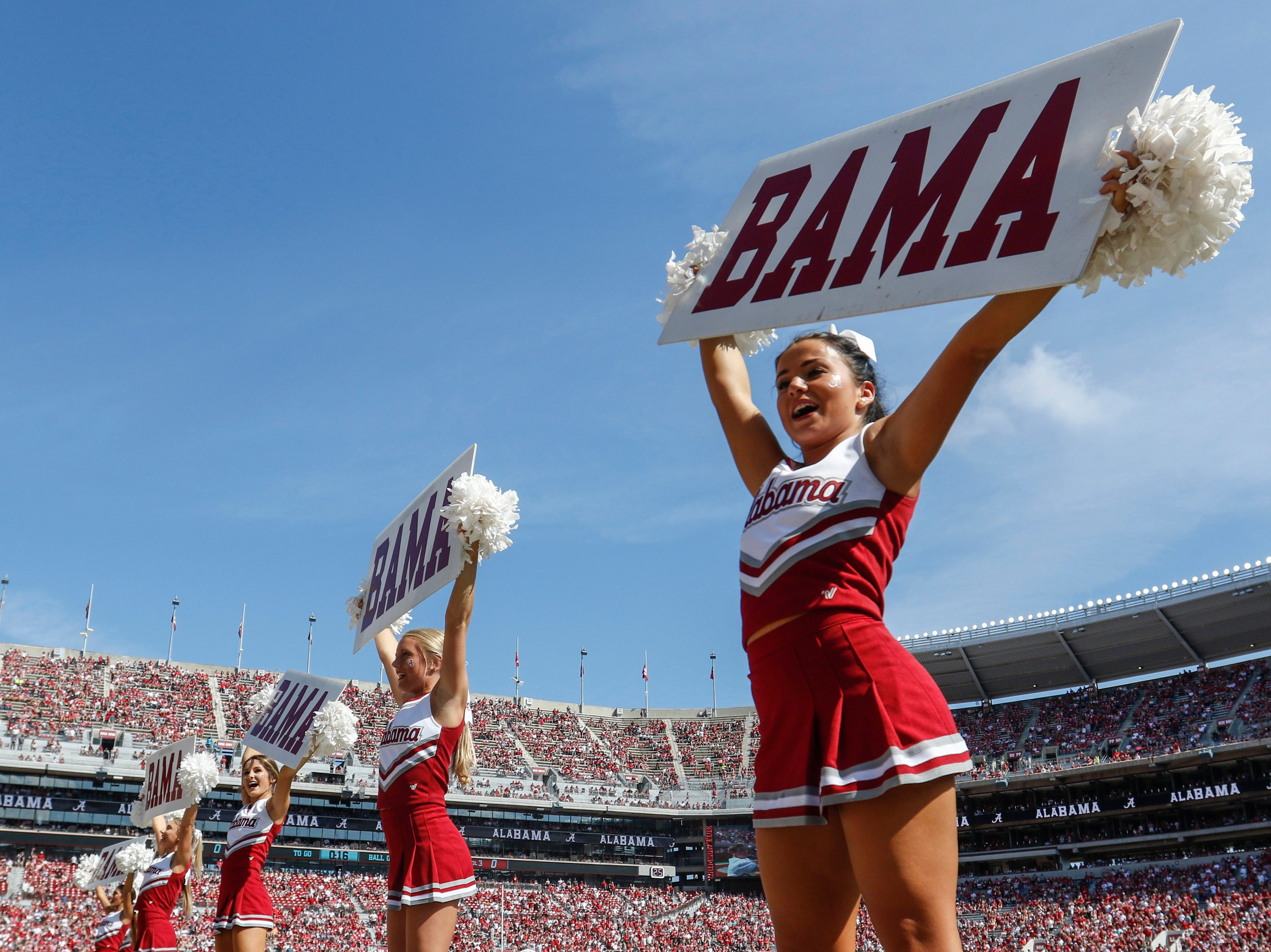 Alabama cheerleaders lead fans in a cheer before the first half of an NCAA college football game between Alabama and Louisiana-Lafayette, Saturday, Sept. 29, 2018, in Tuscaloosa, Ala. (AP Photo/Butch Dill)