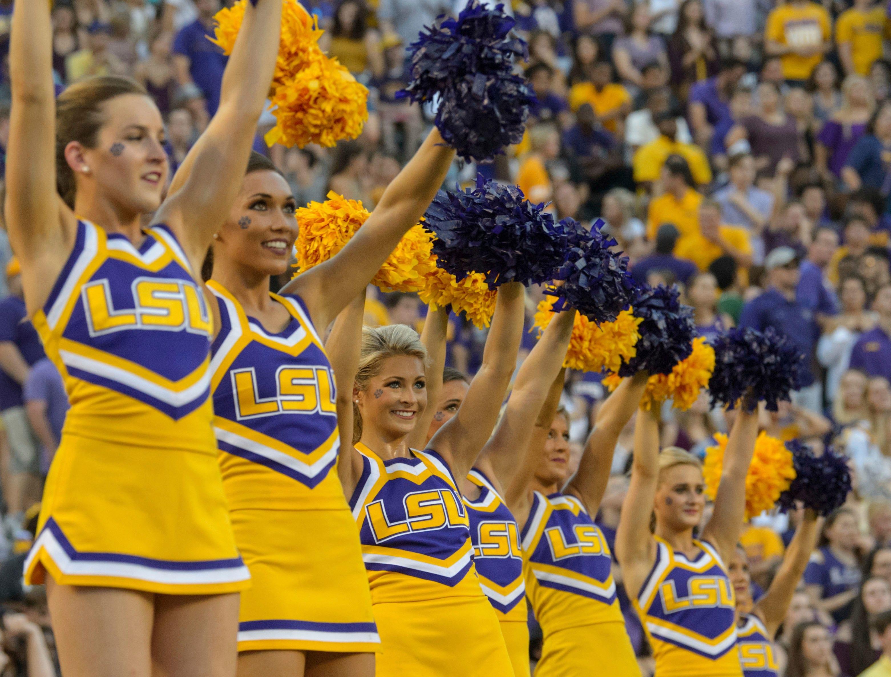 LSU cheerleaders perform against Syracuse in an NCAA college football game in Baton Rouge, La., Saturday, Sept. 23, 2017. (AP Photo/Matthew Hinton)