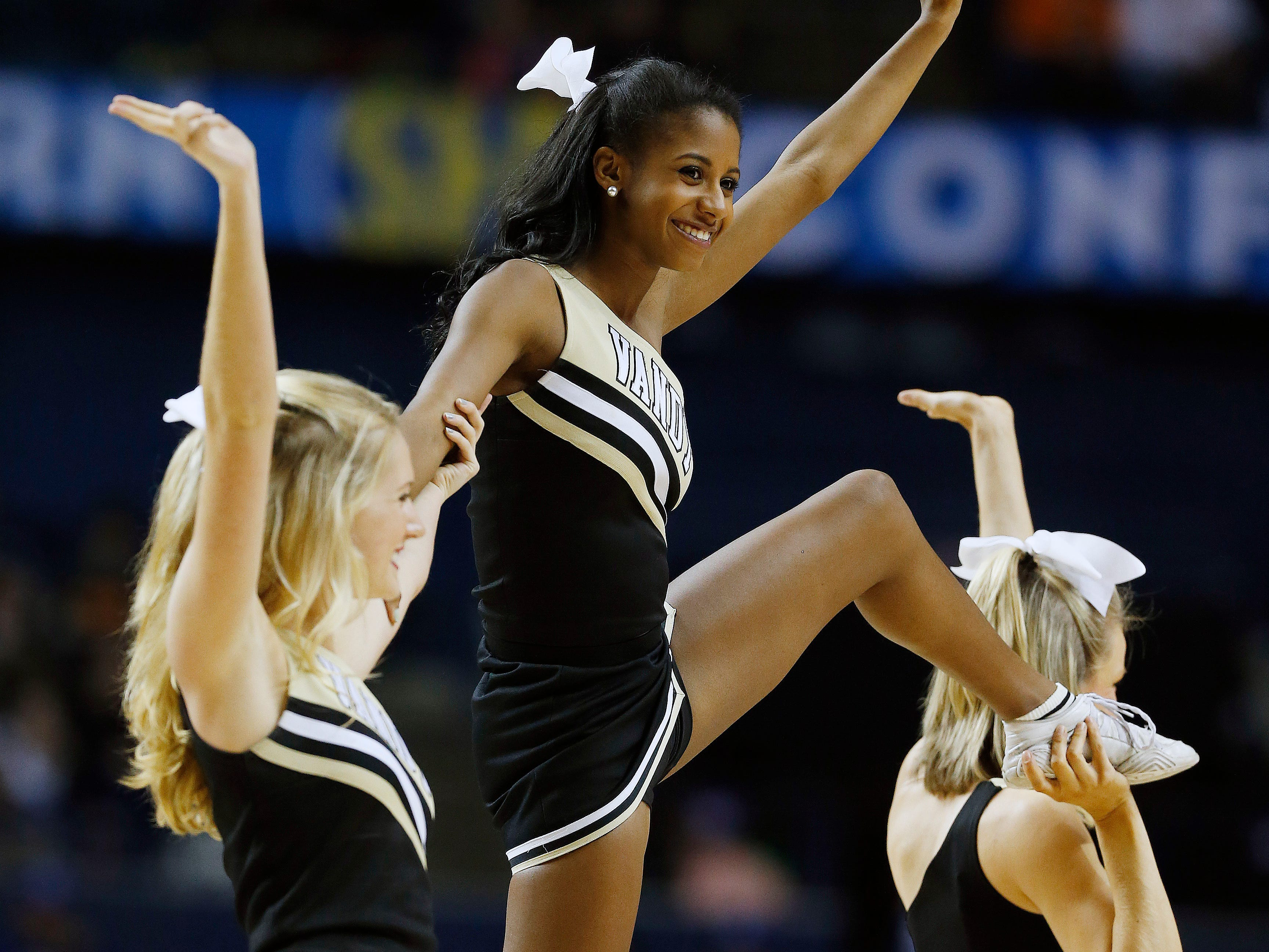 Vanderbilt cheerleaders perform during the first half of an NCAA college basketball game in the second round of the Southeastern Conference tournament between Tennessee and anderbilt, Thursday, March 12, 2015, in Nashville, Tenn. (AP Photo/Steve Helber)