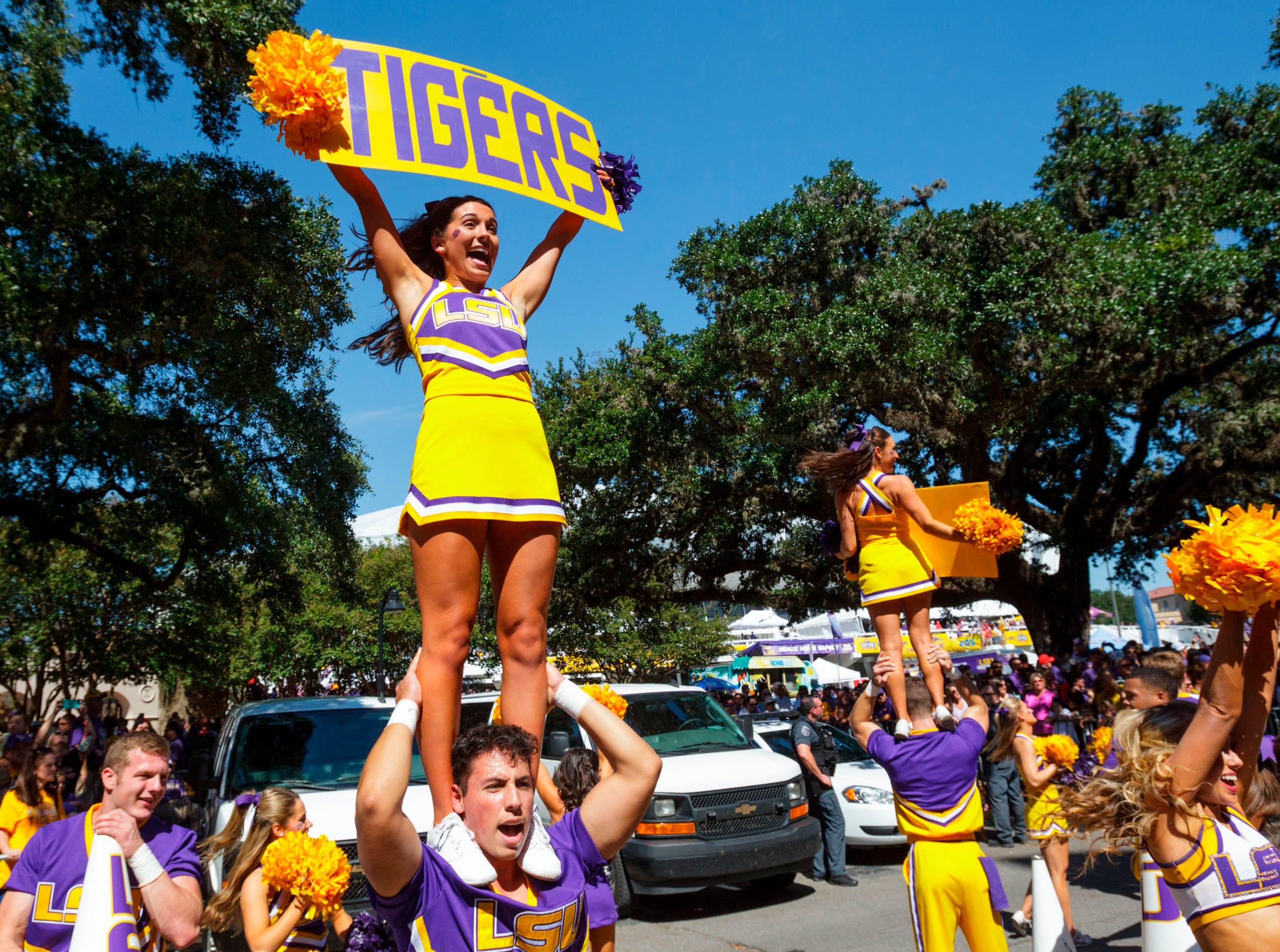 The LSU cheerleaders perform before an NCAA college football against Georgia in Baton Rouge, La., Saturday, Oct. 13, 2018. (AP Photo/Matthew Hinton)