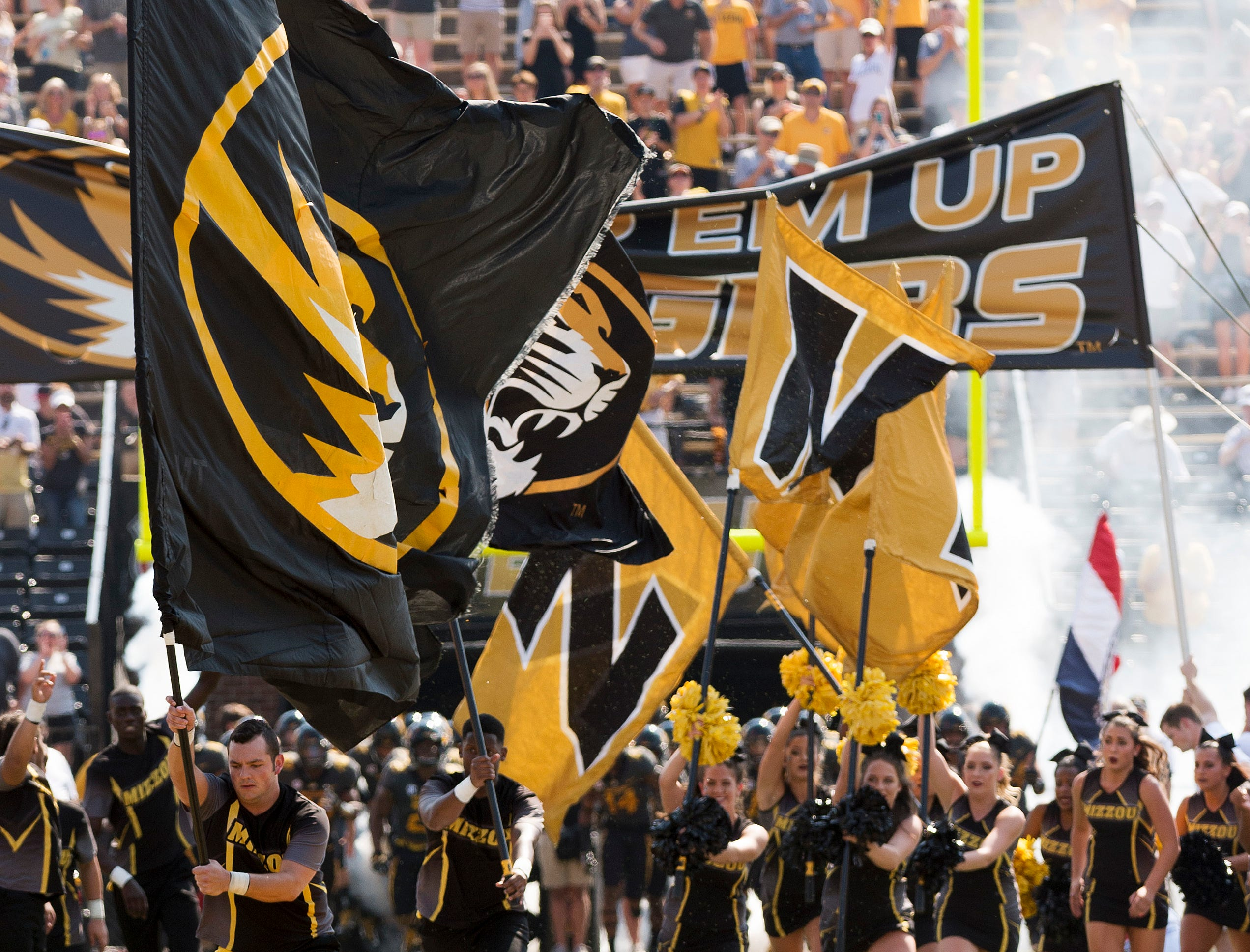 The Missouri cheerleaders lead the football team to the field before the start of an NCAA college football game against Purdue Saturday, Sept. 16, 2017, in Columbia, Mo. (AP Photo/L.G. Patterson)