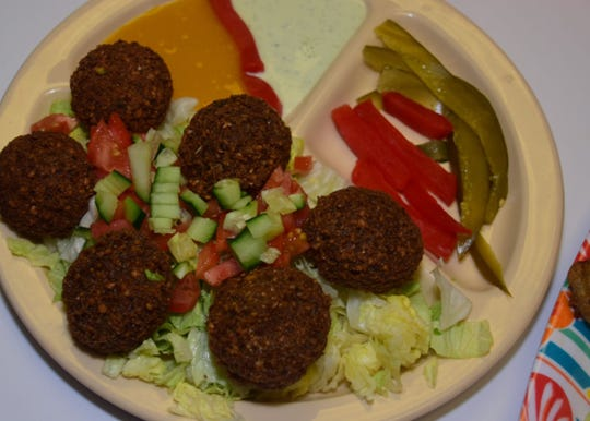 A falafel is a ball of deep fried chick peas similar to a hushpuppy.