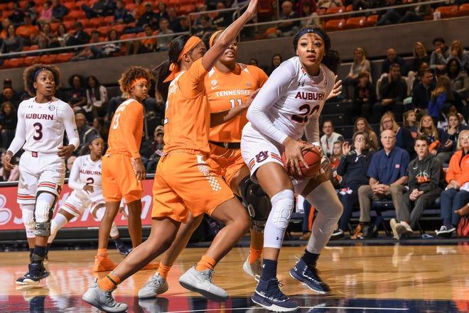 Tennessee defenders Evina Westbrook  (2) and Kasi Kushkituah (11) converge on Auburn's Unique Thompson