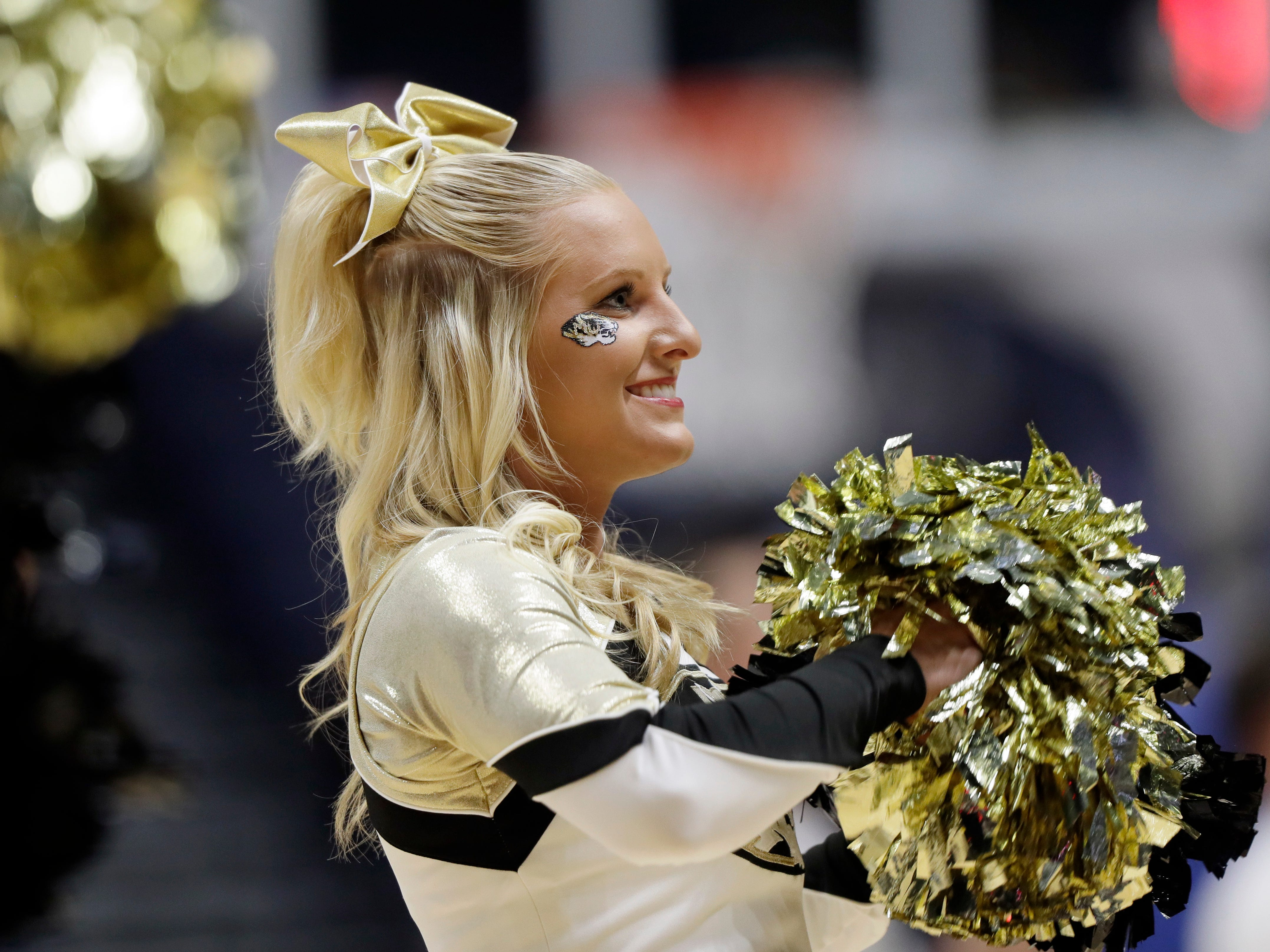 A Missouri cheerleader performs during the second half of an NCAA college basketball game against Auburn at the Southeastern Conference tournament Wednesday, March 8, 2017, in Nashville, Tenn. (AP Photo/Wade Payne)