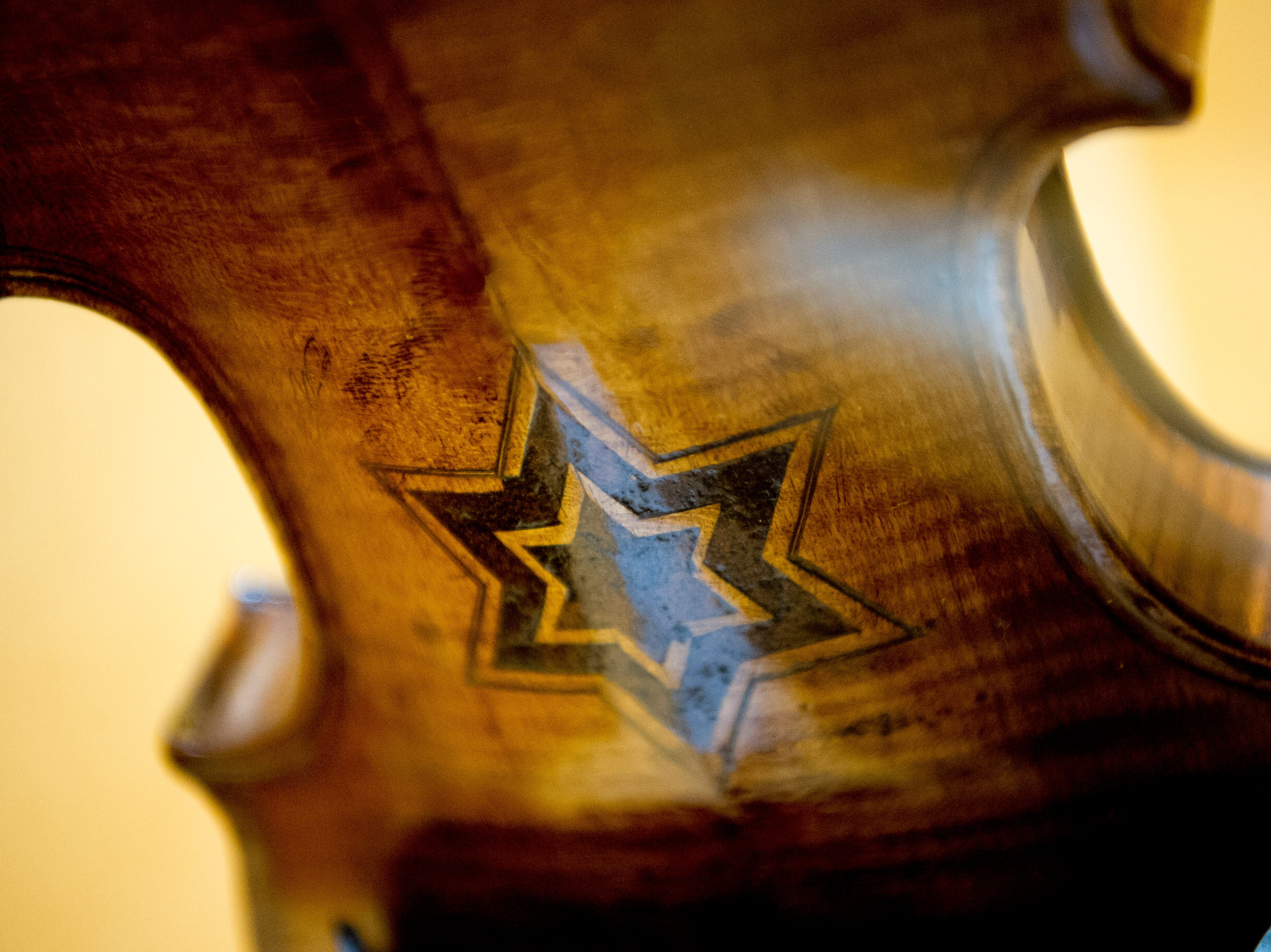 A Star of David seen on a violin at the Violins of Hope exhibit at the University of Tennessee Downtown Gallery, 106 S. Gay St., in Knoxville, Tennessee on Friday, January 4, 2019. The exhibit, from Israel, features 38 violins that were played by Jewish musicians during the Holocaust. The display runs from Jan. 4-27.